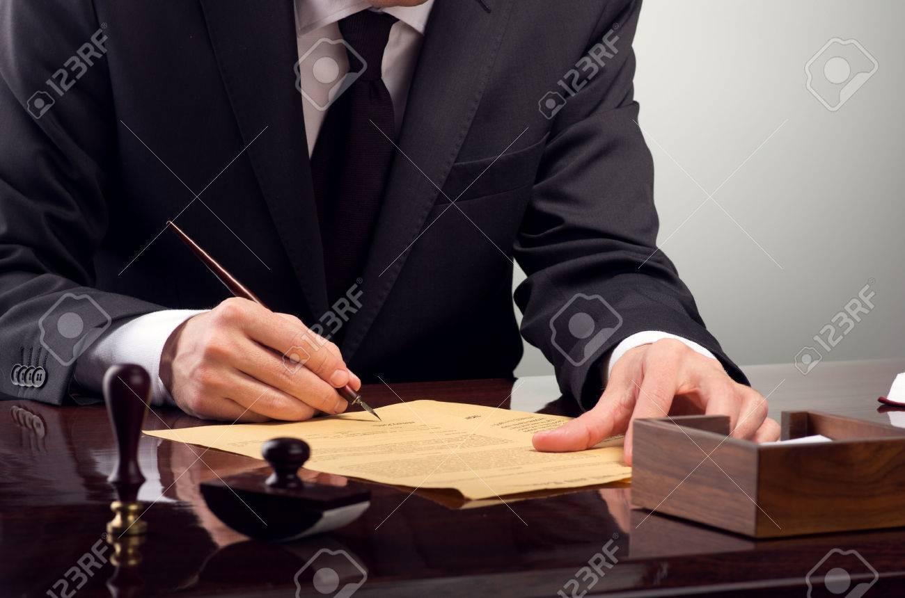 Businessman notarize testament at notary public office Stock Photo - 23132451