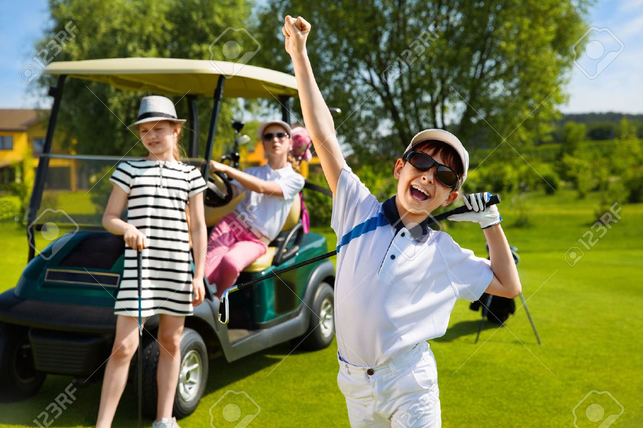 Children playing golf and taking part on kids competition in golf course at summer day Stock Photo - 44195828