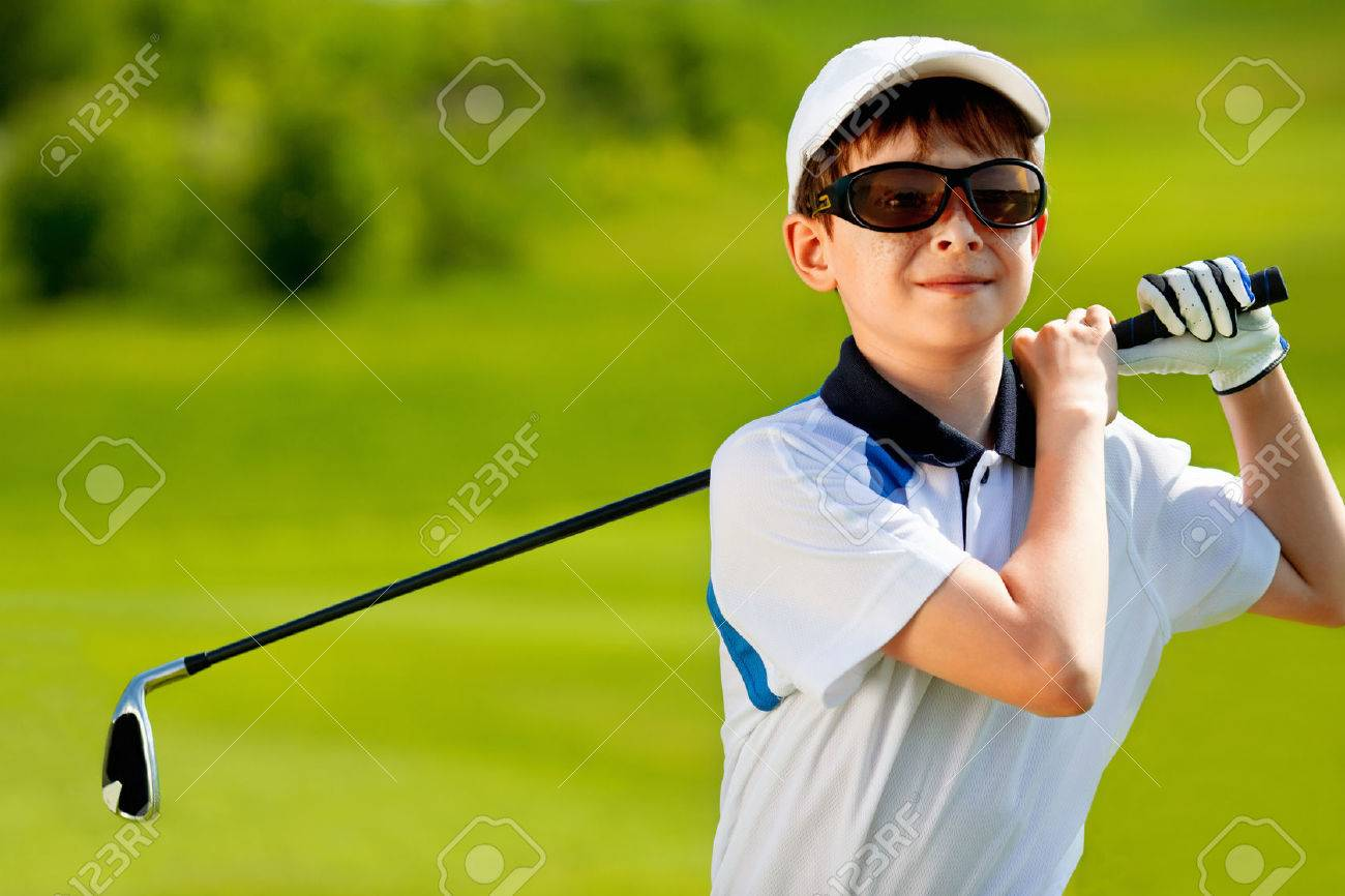 Portrait of boy golfer in golf course at summer day Stock Photo - 44258433