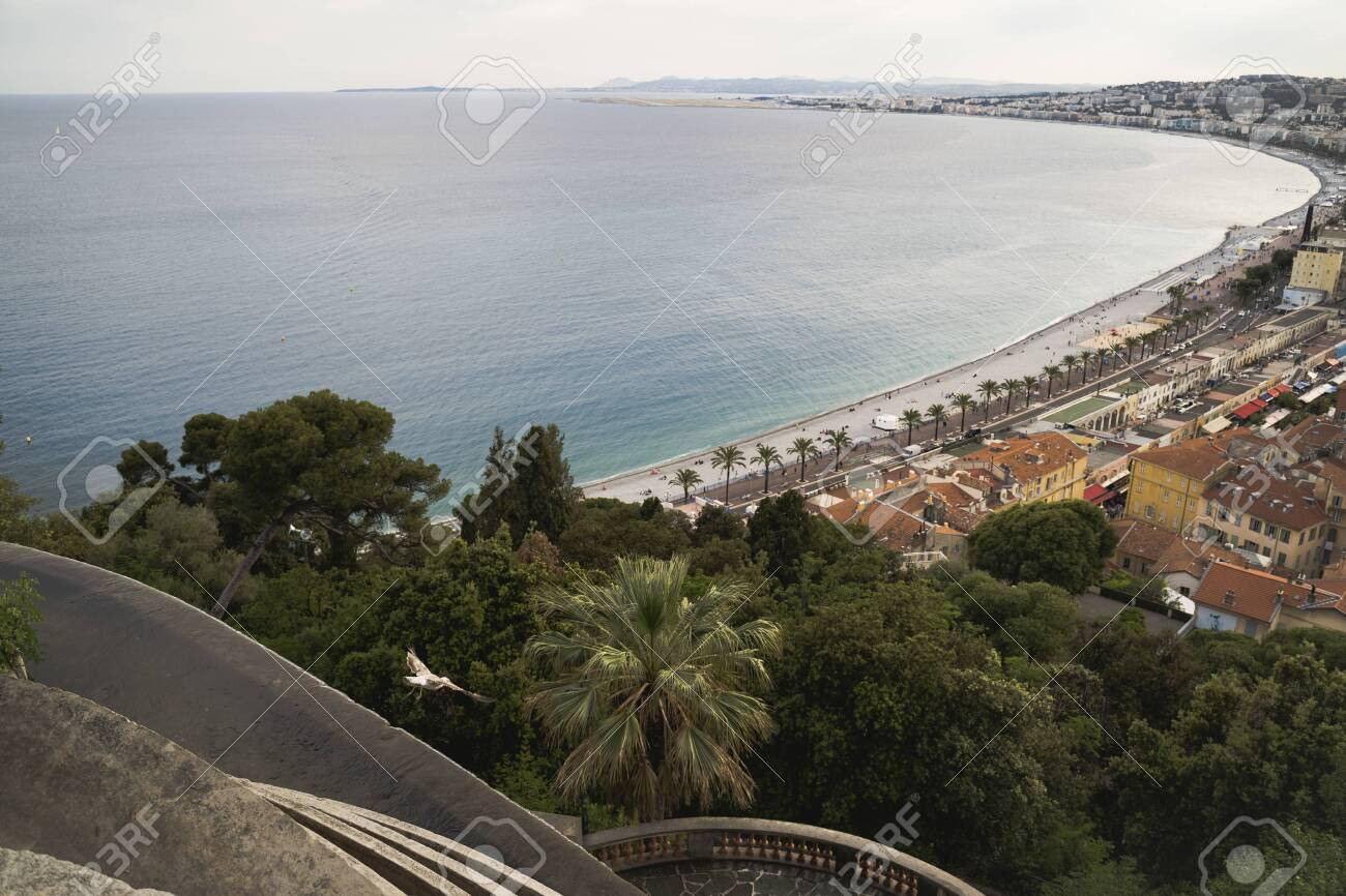 Luxury resort of French riviera. Beautiful view at city of Nice in France. Mediterranean sea, public beach, famous quay, palms and houses of Nice. - 131935586
