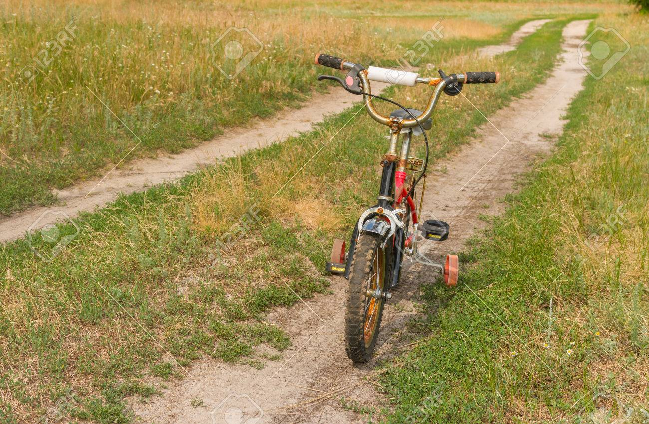 Rusty Kids Three Wheeled Bicycle Waiting For The Master On The