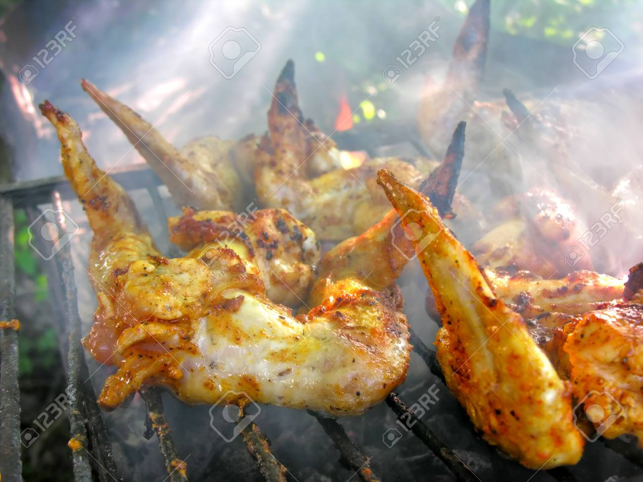 chicken wings grilling at weekend in the summer Stock Photo - 17099997