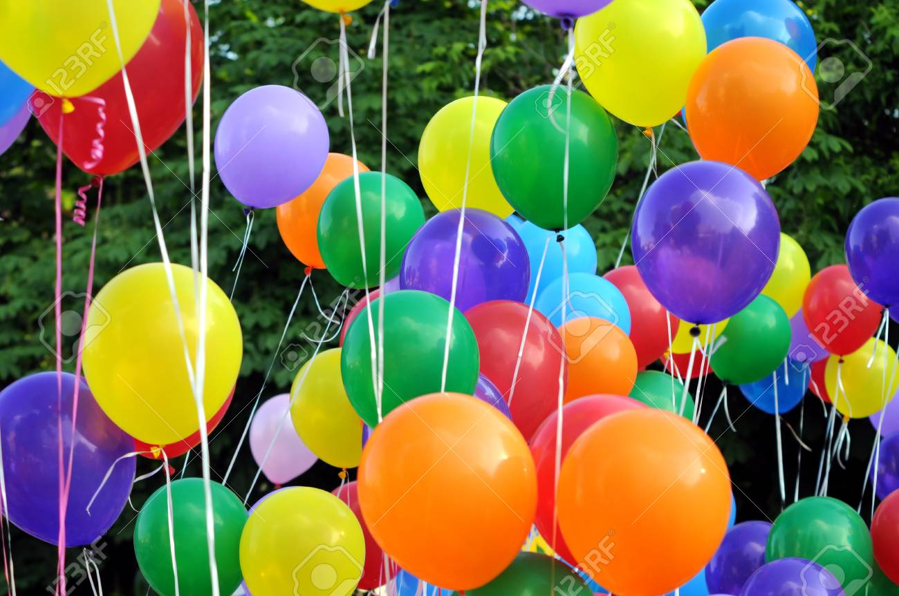 Multicolored Balloons In The City Festival On Trees Background Stock ...
