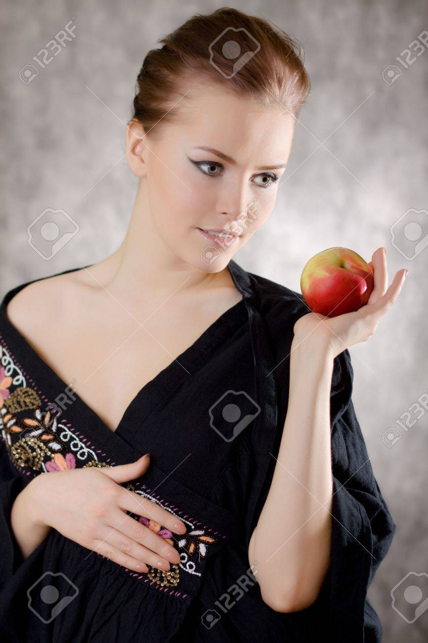 woman apple dream gray background Stock Photo - 6511538