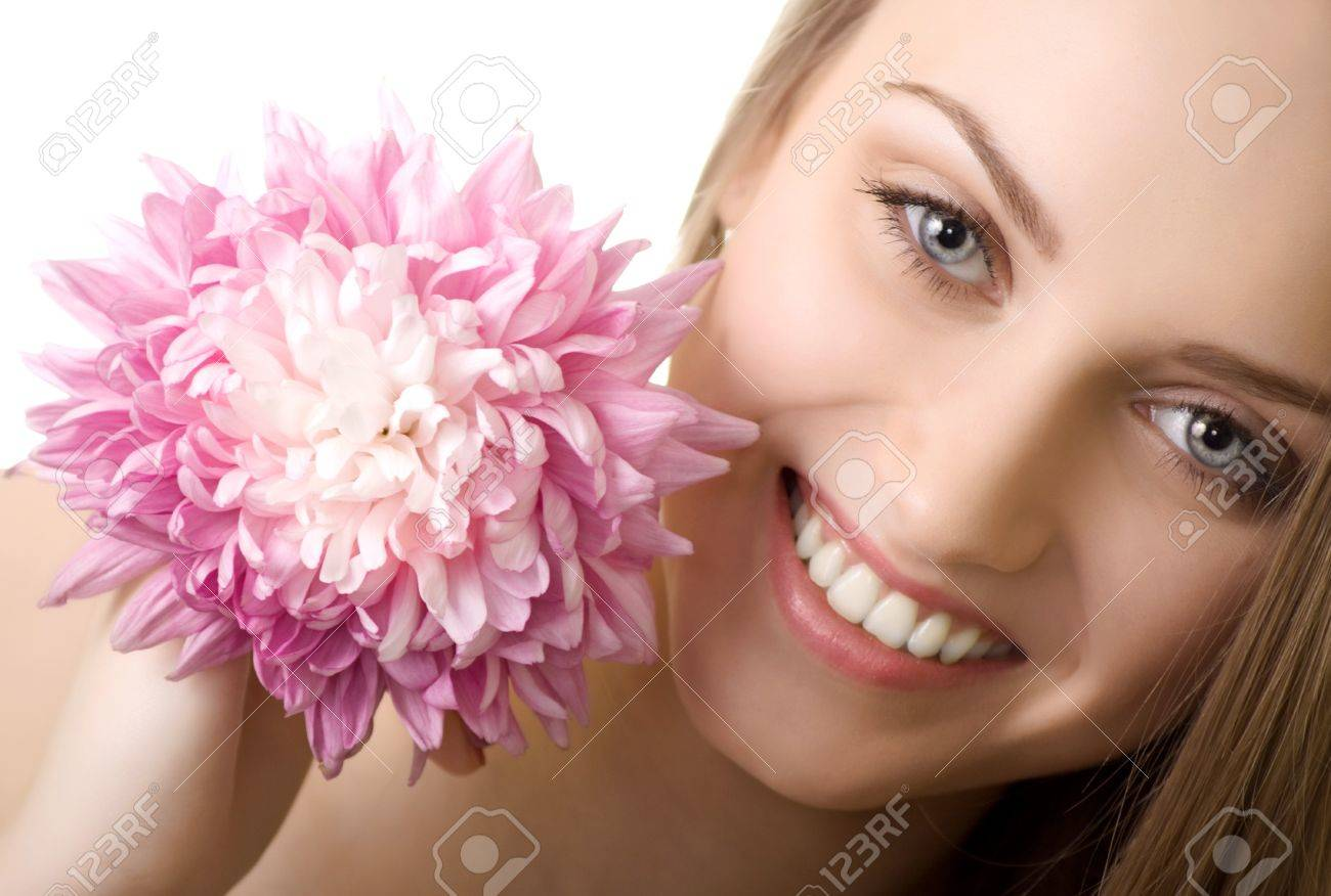 beautiful smile woman with flower isolated Stock Photo - 7893825