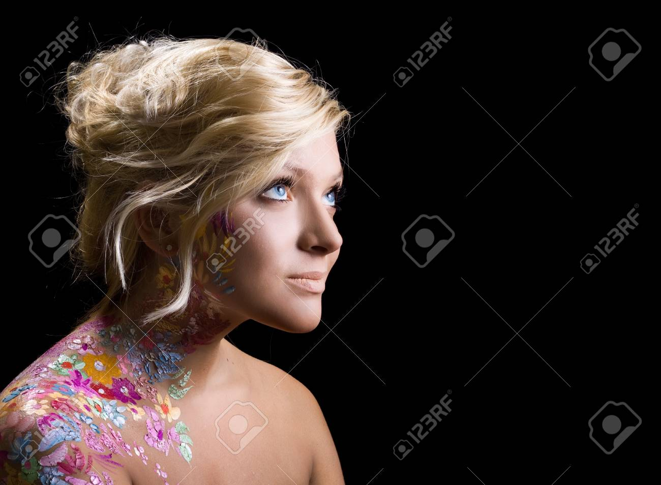 portrait of beautiful girl with floral theme bodyart on black background Stock Photo - 8192646