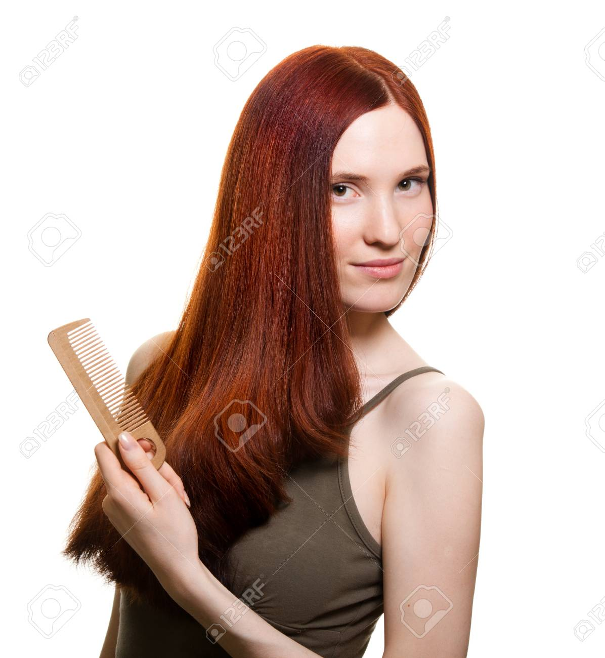 portrait of a beautiful young woman comb wonderful hair Stock Photo - 9369465