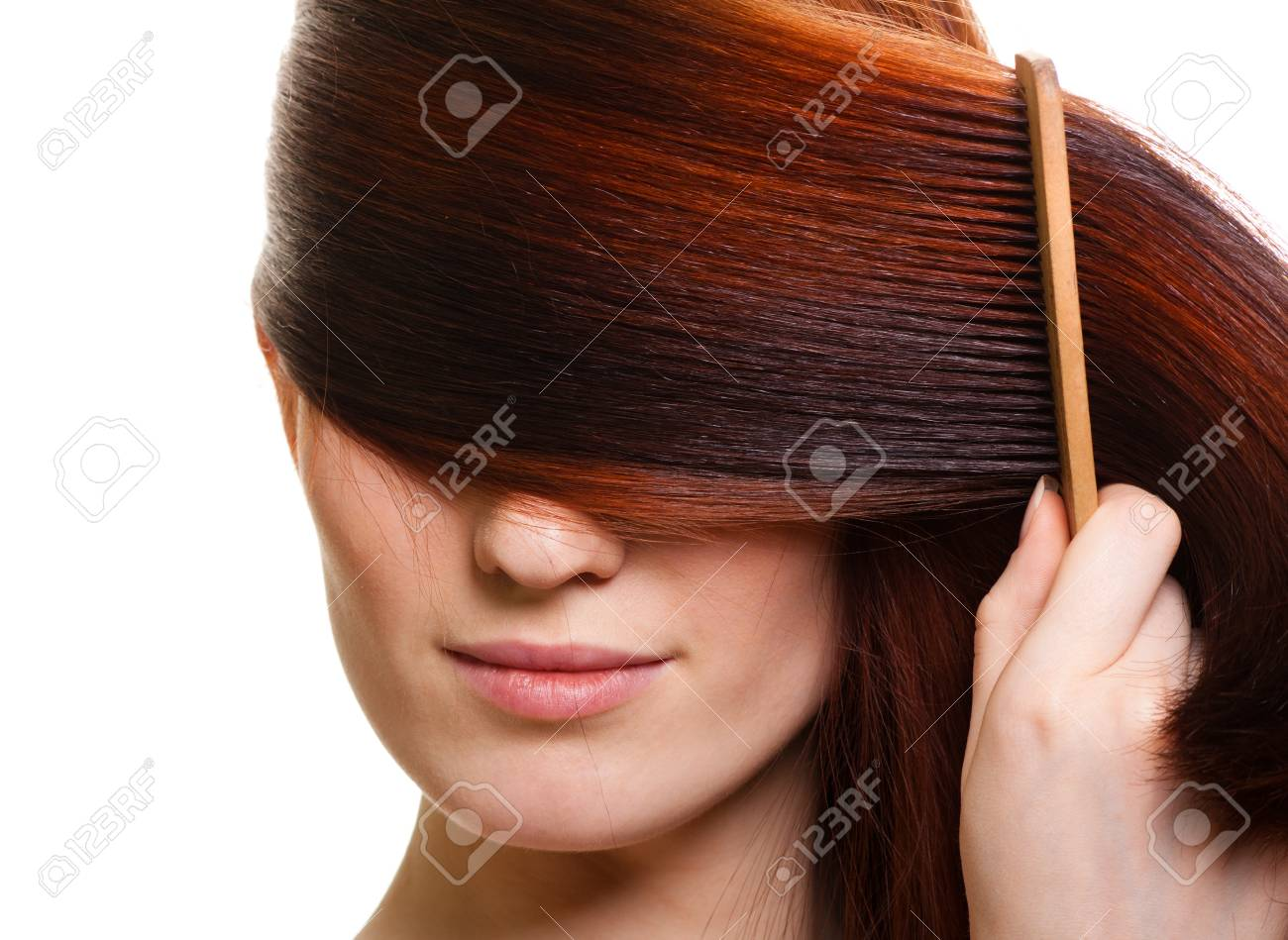 portrait of a beautiful young woman comb wonderful hair Stock Photo - 9369503