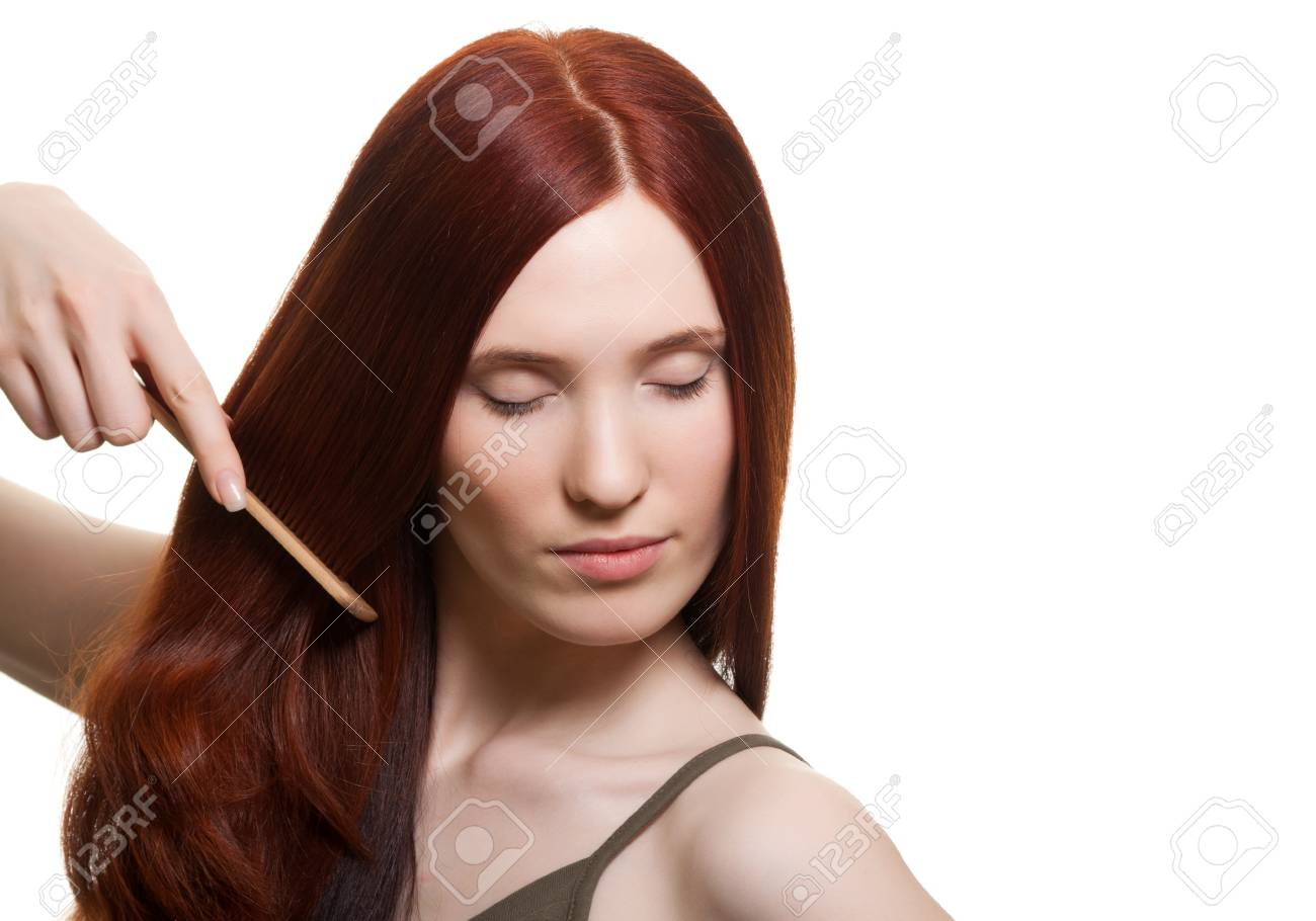 portrait of a beautiful young woman comb wonderful hair Stock Photo - 9613478
