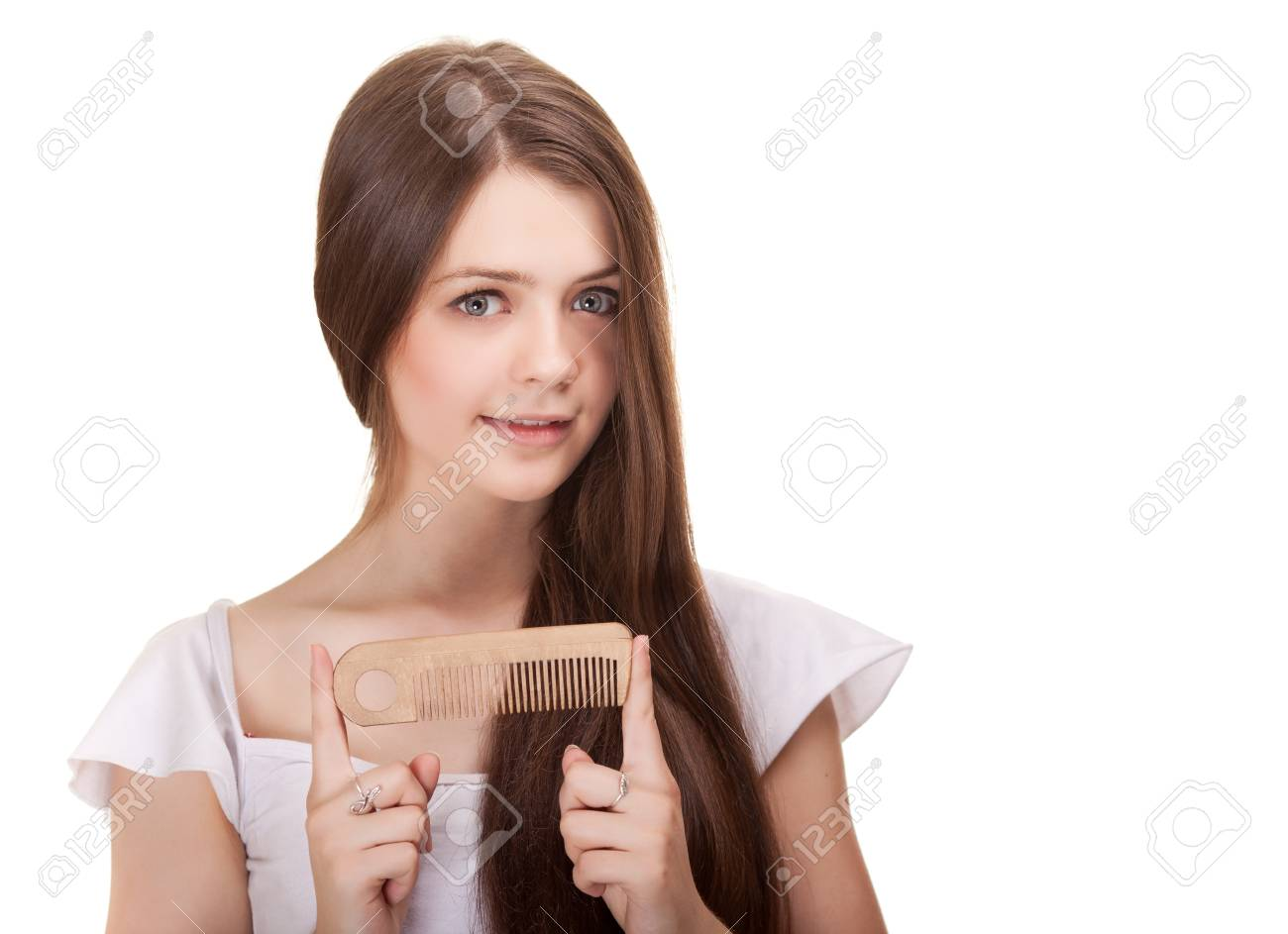 portrait of a beautiful youth teen girl with comb isolated Stock Photo - 9617612