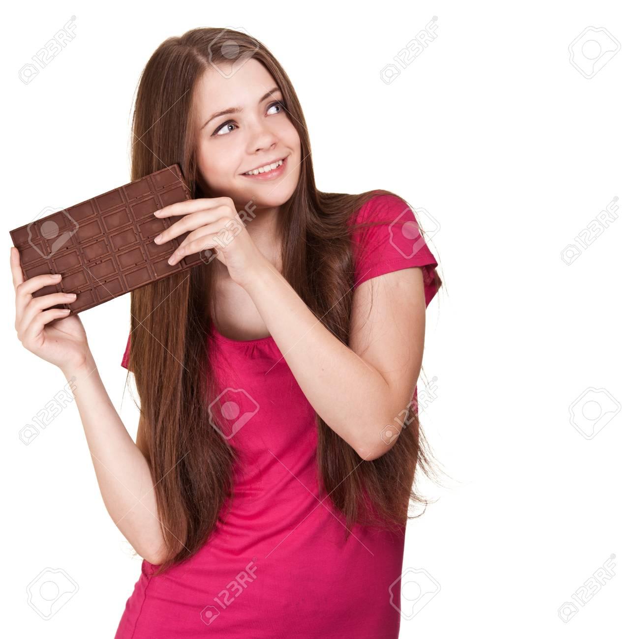 Shot of a beautiful teen girl holding big chocolate bar Stock Photo -  9613652