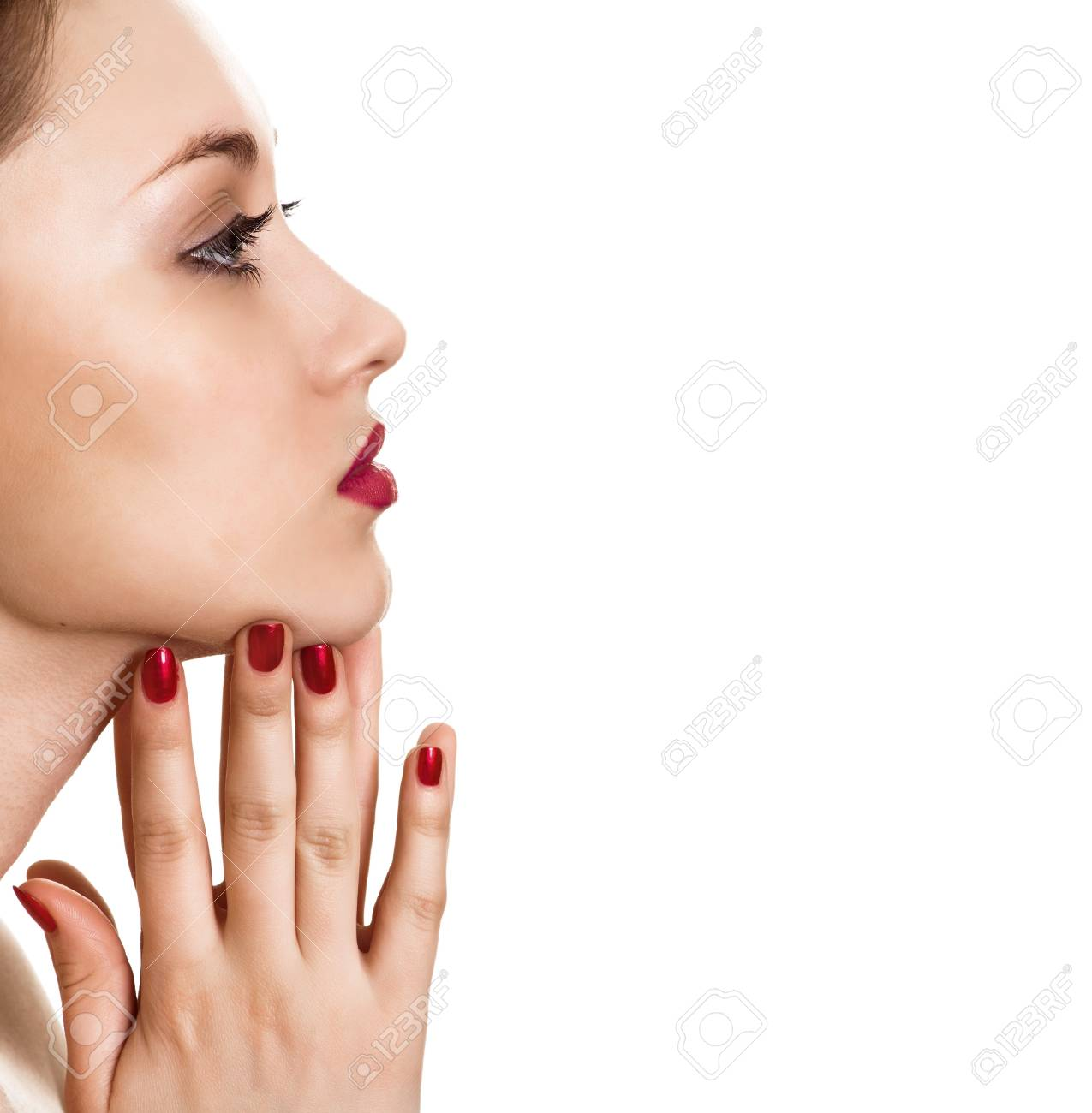 portrait of beauty woman with red bright manicure on white background Stock Photo - 9809188