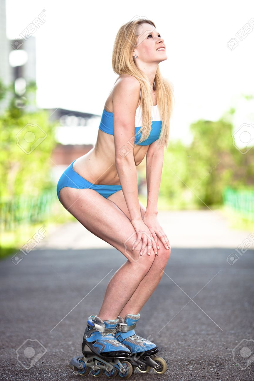happy young blond woman on roller skates in the park Stock Photo - 9999822