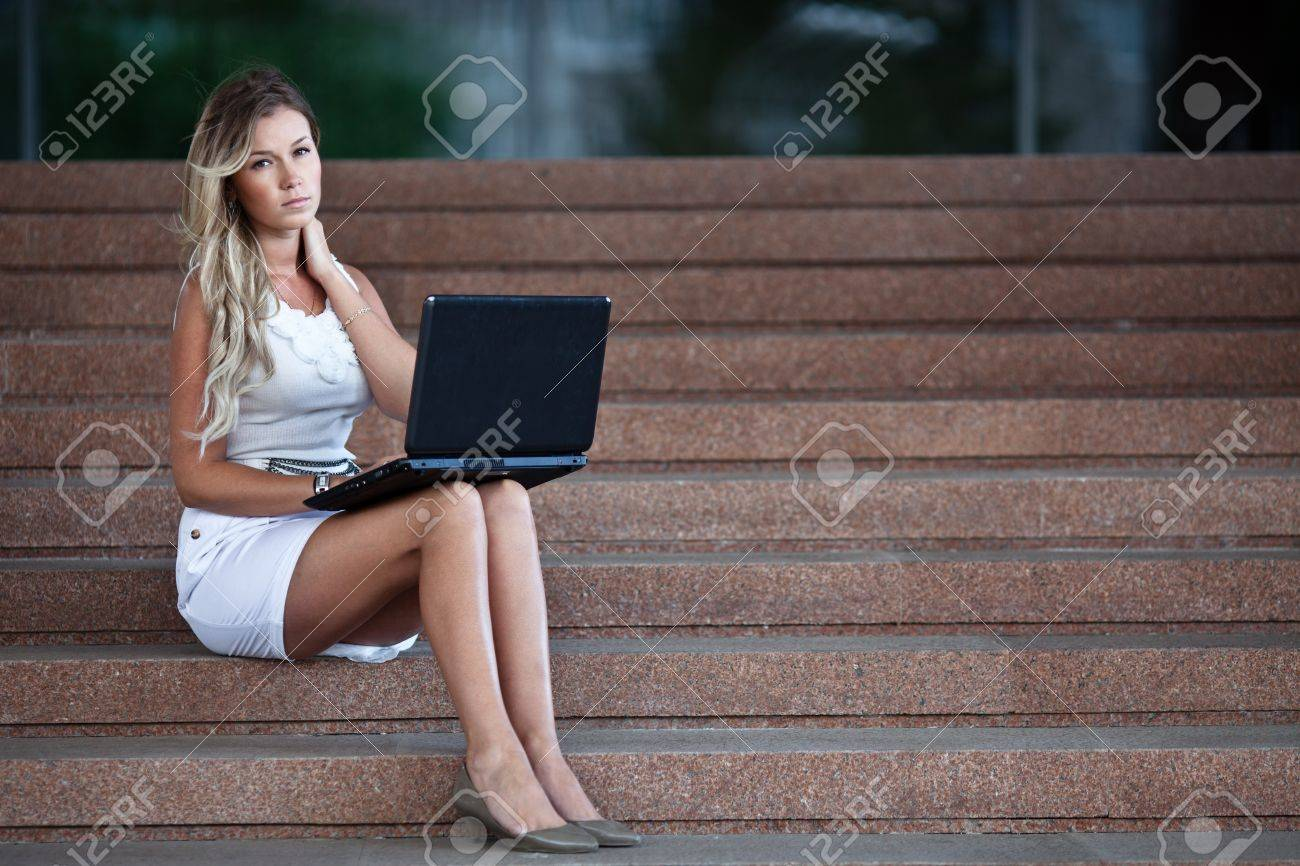 Young attractive businesswoman with a notebook Stock Photo - 10172592