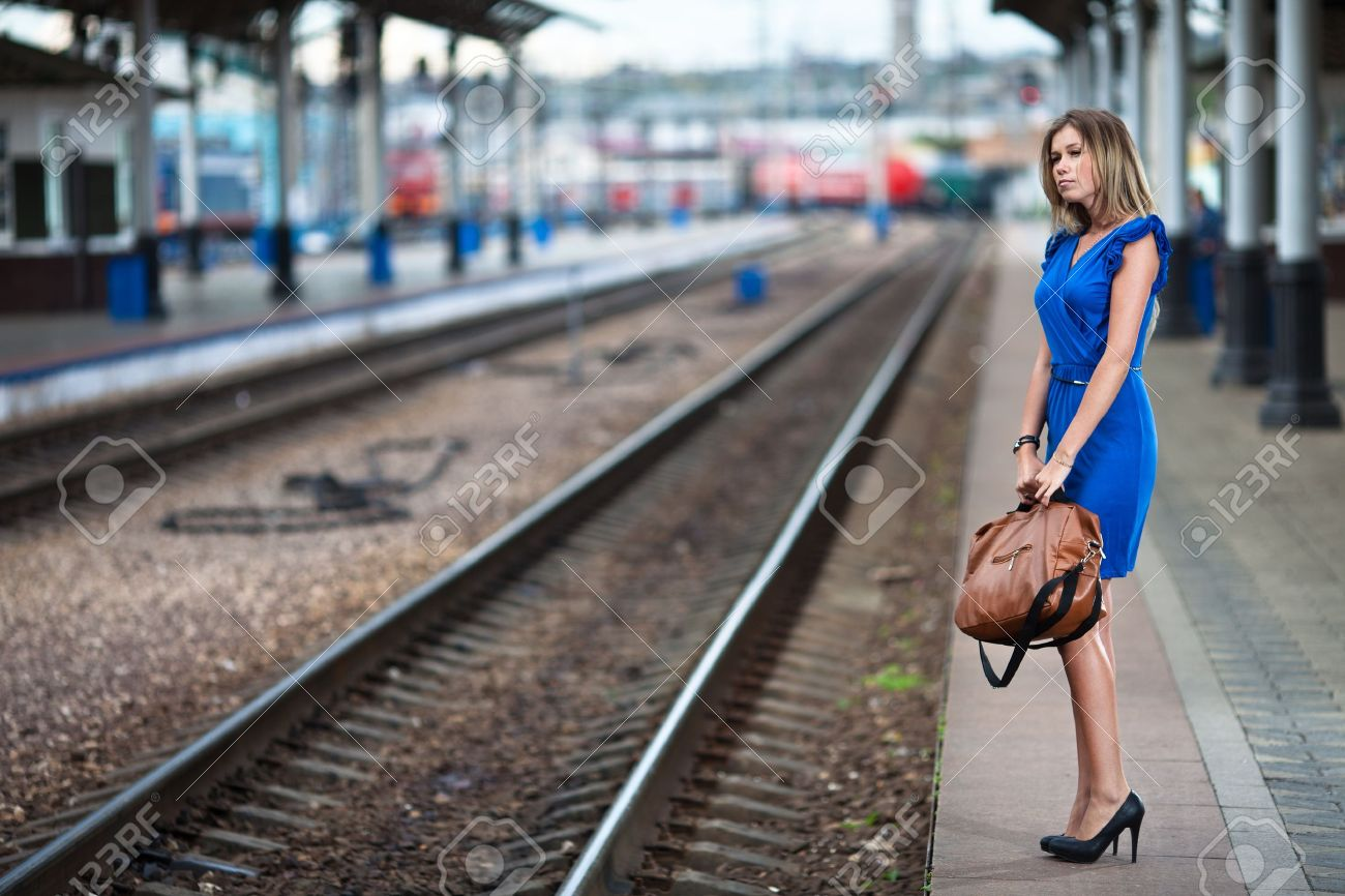attractive lady waiting train on the platform of railway station Stock Photo - 10172631