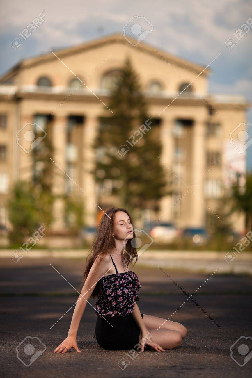 young woman sitting at the street in city Stock Photo - 10172609