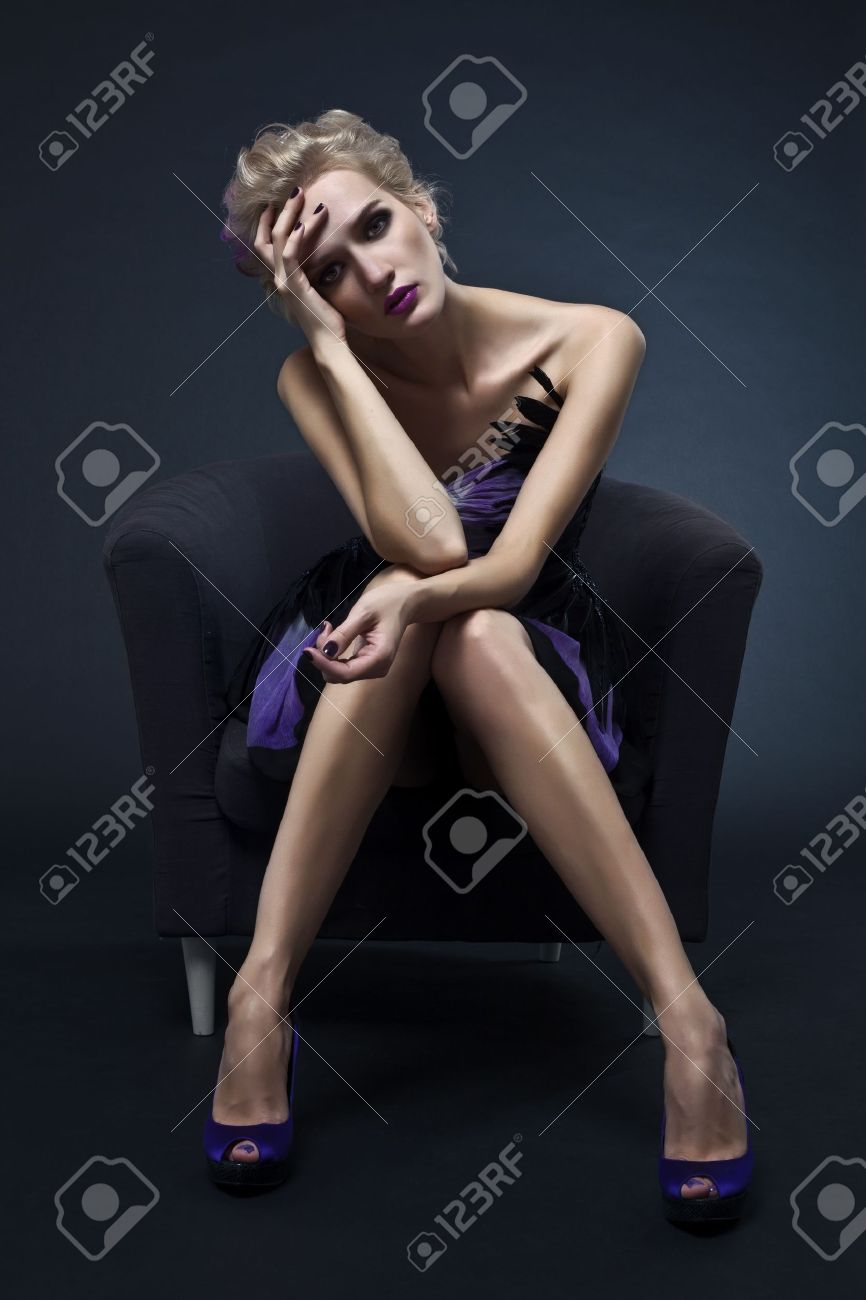 The image of a beautiful luxurious woman sitting on chair. Studio shot Stock Photo - 10487673