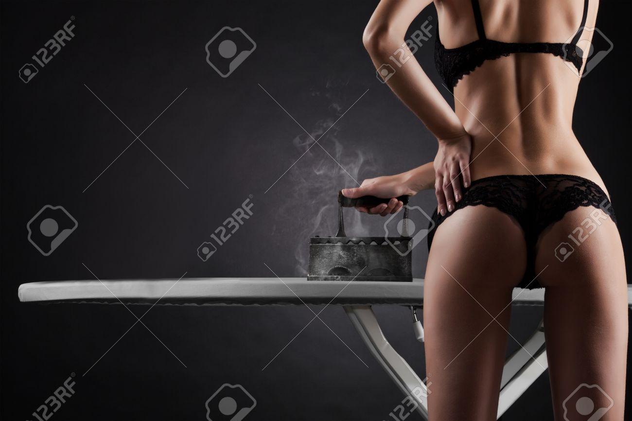 sexy woman with  retro iron on black background Stock Photo - 11590846