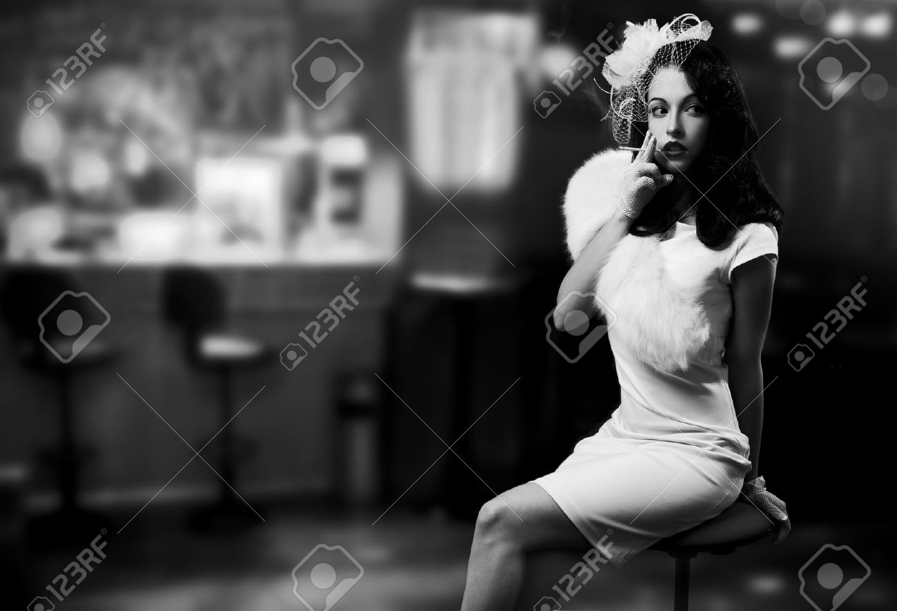 Retro Style Image. Smoking Lady In The Bar Stock Photo - 12637925