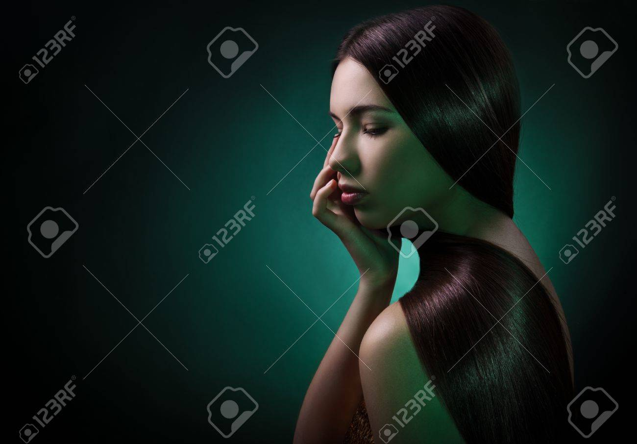 Fashion portrait of a brunette woman. Healthy Long Hair Stock Photo - 12638815