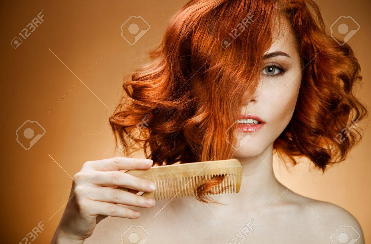 Beauty Portrait. Curly Hair and Comb Stock Photo - 12638798