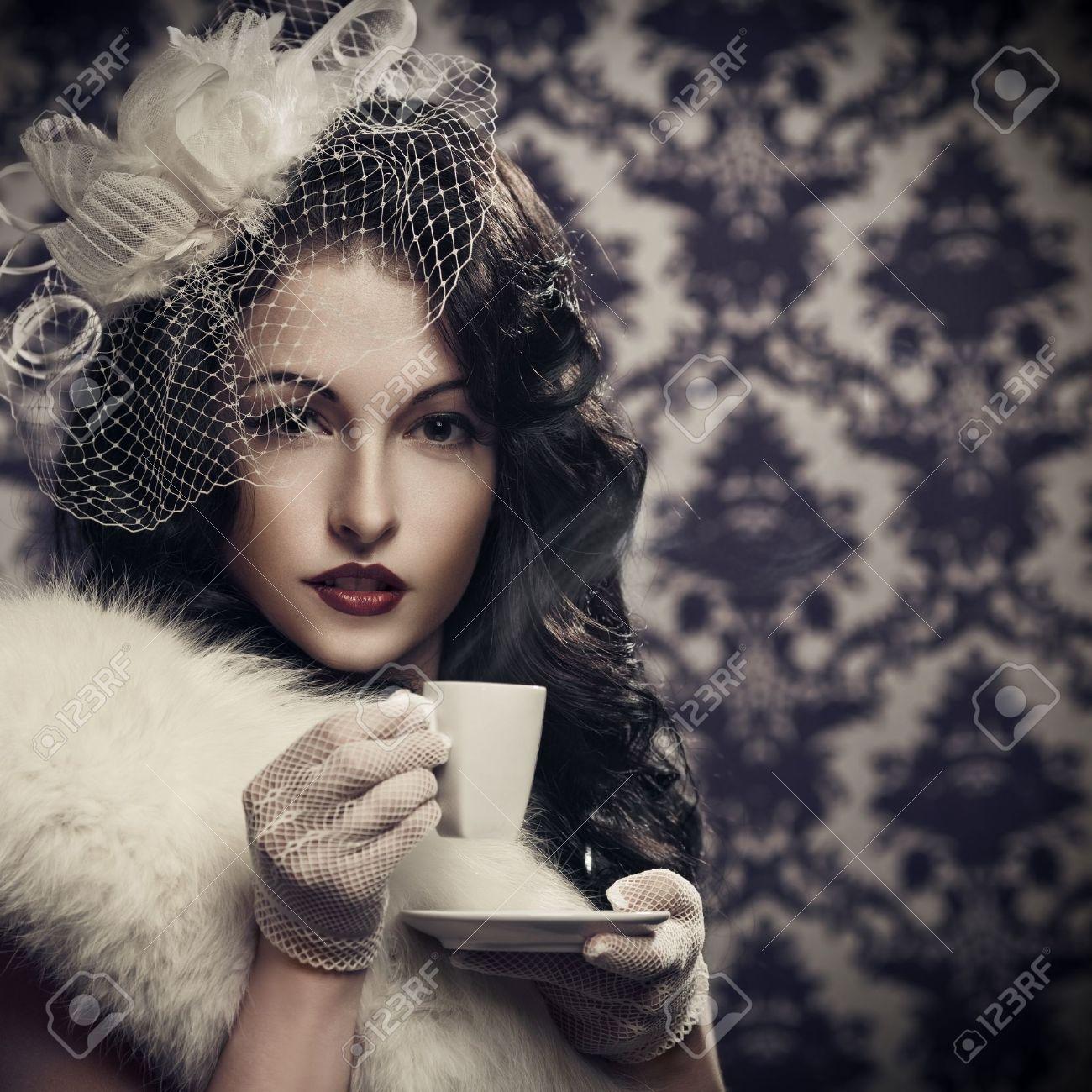 Young beautiful retro lady drinking coffee Stock Photo - 12639265