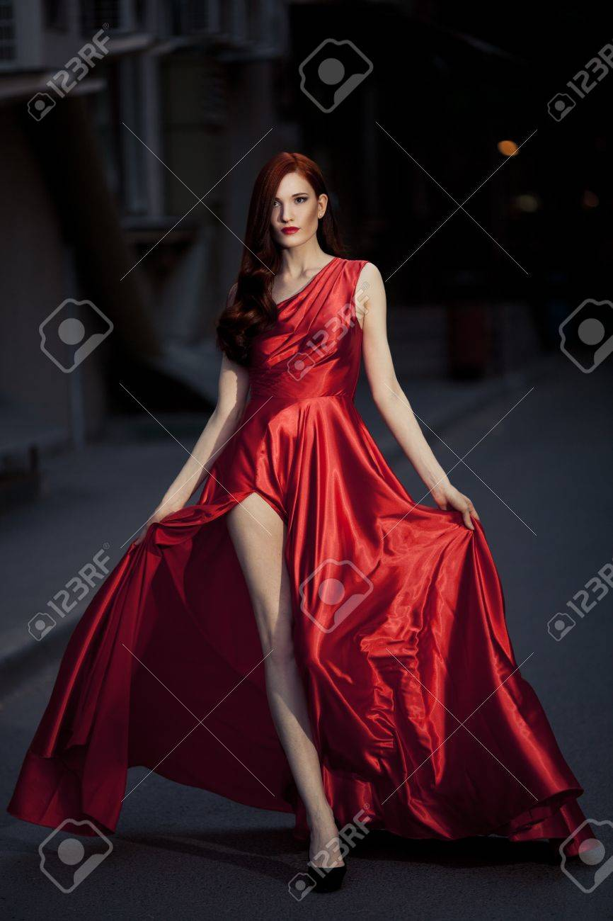 Young Beauty Famous Woman In Red Dress Outdoor Stock Photo - 16732209