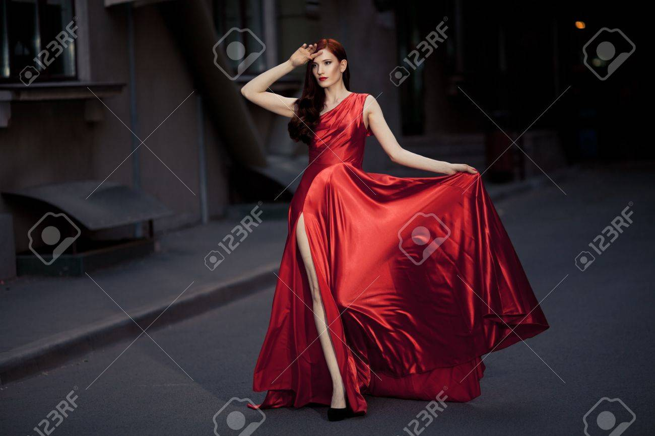 Young Beauty Famous Woman In Red Dress Outdoor Stock Photo - 16732210