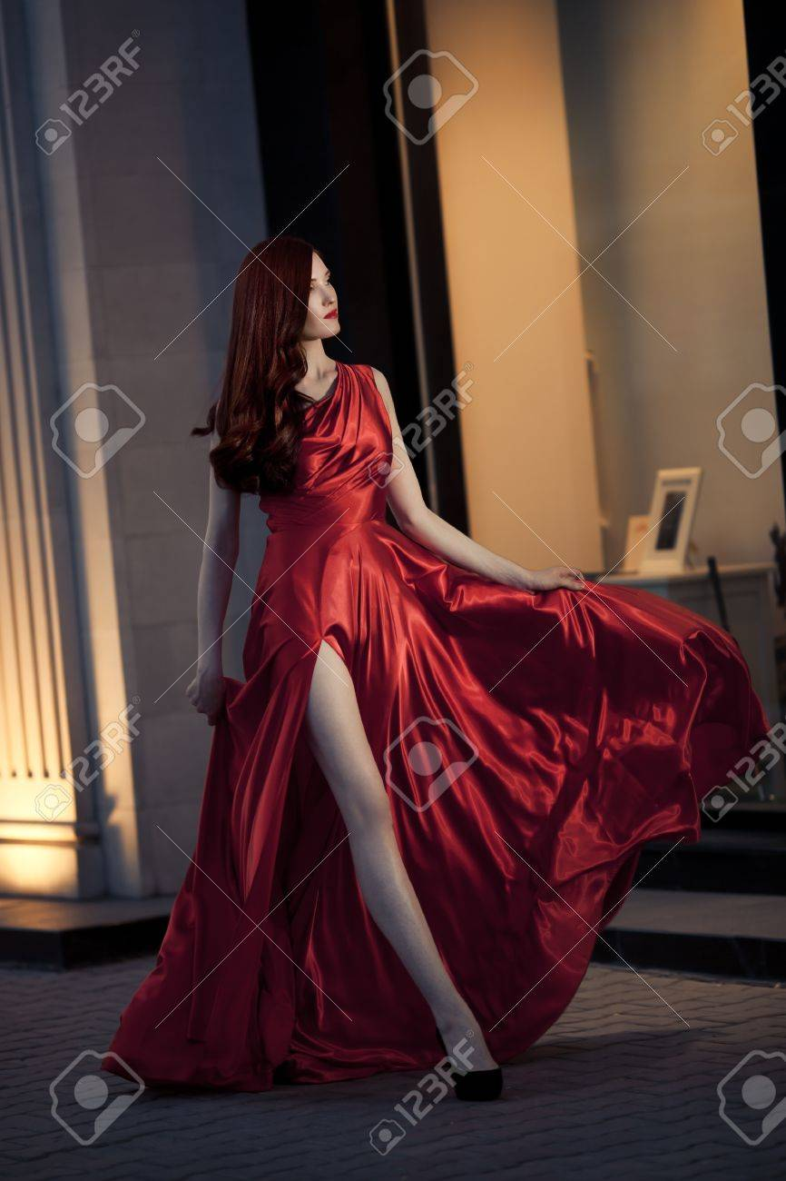 Young Beauty Famous Woman In Red Dress Outdoor Stock Photo - 16732202