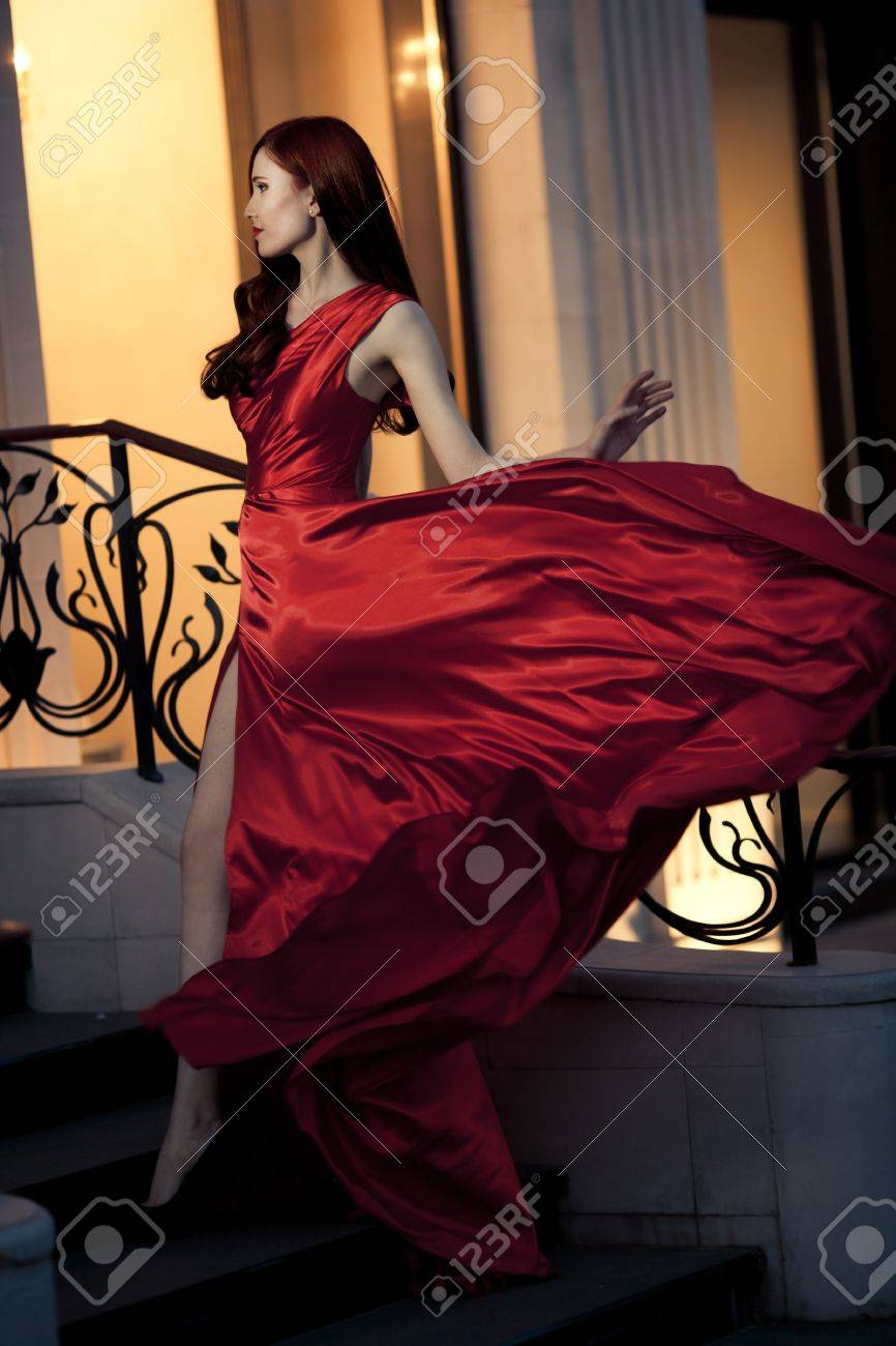 Young Beauty Famous Woman In Red Dress Outdoor Stock Photo - 16732200