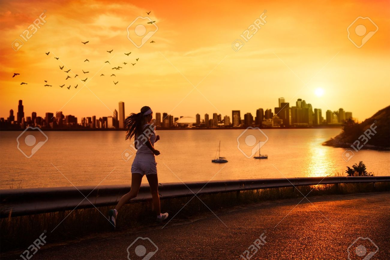 Young woman running at sunset Stock Photo - 17934806