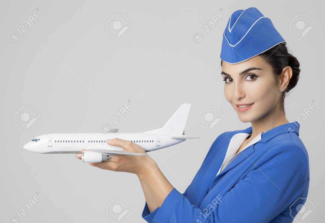 Charming Stewardess Holding Airplane In Hand. - 32514531
