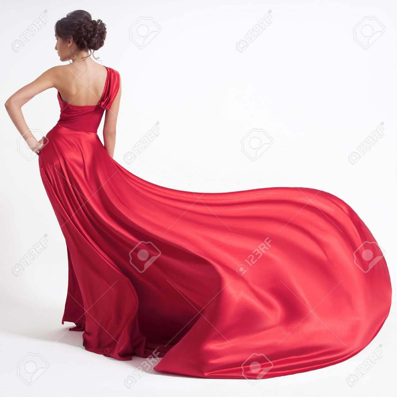 Young beauty woman in fluttering red dress. White background. - 37538089