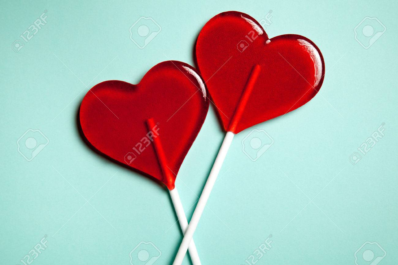 Two lollipops. Red hearts. Candy. Love concept. Valentine day. - 42489691