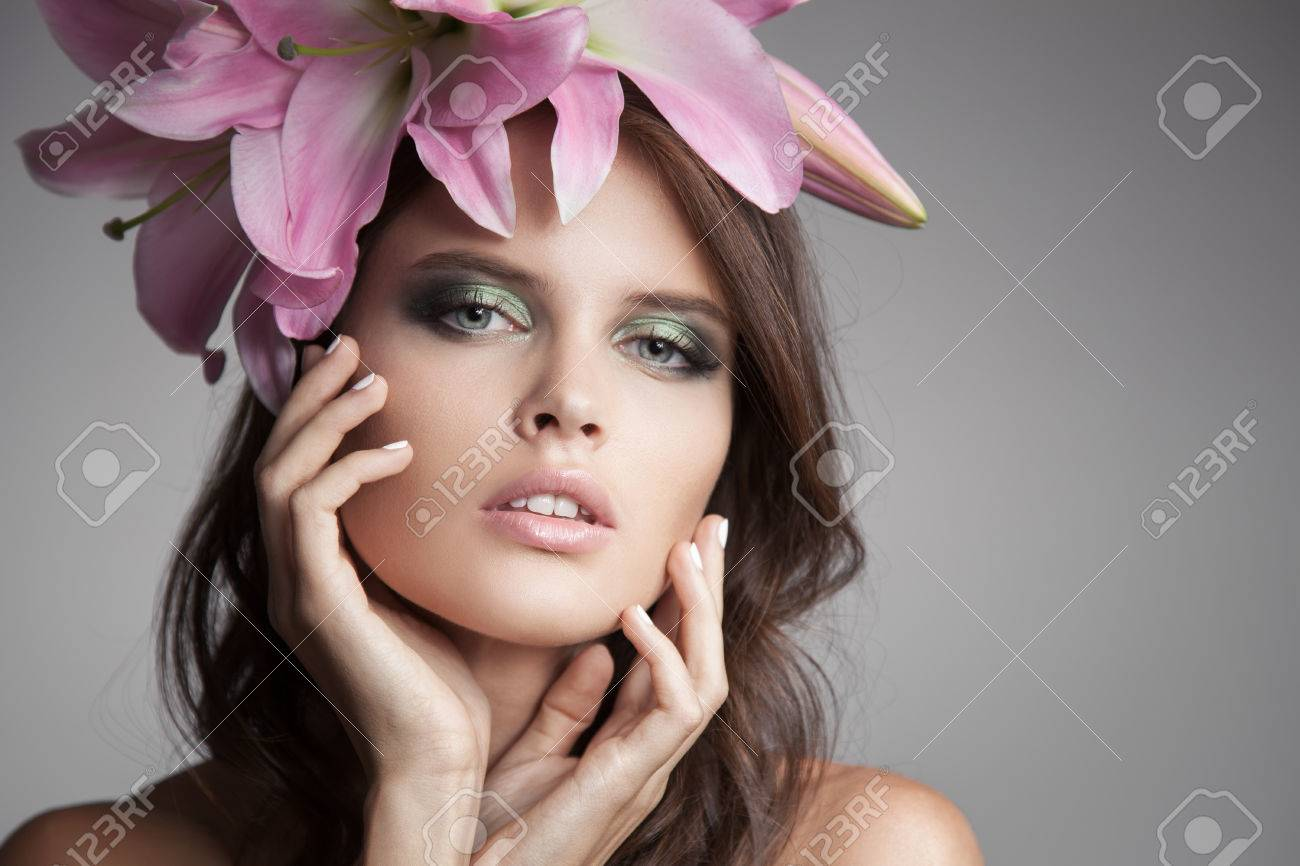 Beautiful woman with flowers wreath in her hair pink lily stock beautiful woman with flowers wreath in her hair pink lily stock photo 64800717 dhlflorist Gallery