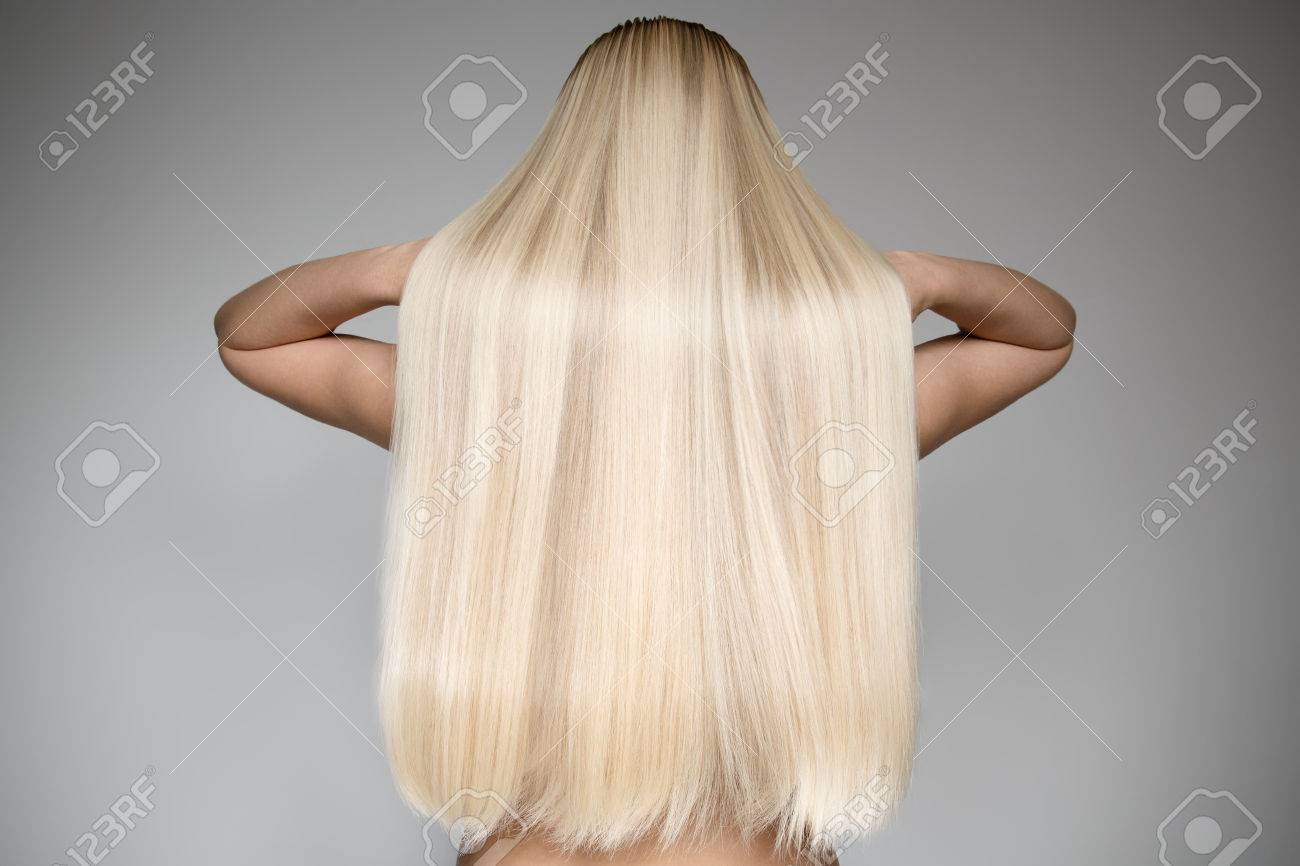 Portrait Of A Beautiful Young Blond Woman With Long Straight Hair. Back View - 66576144