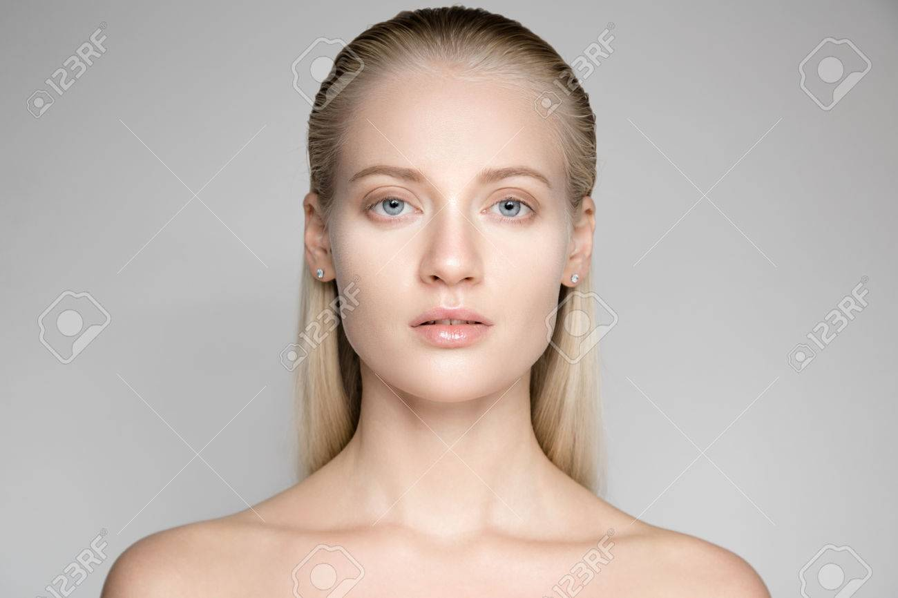 Portrait Of A Beautiful Young Blond Woman With Long Slicked Hair - 66563098