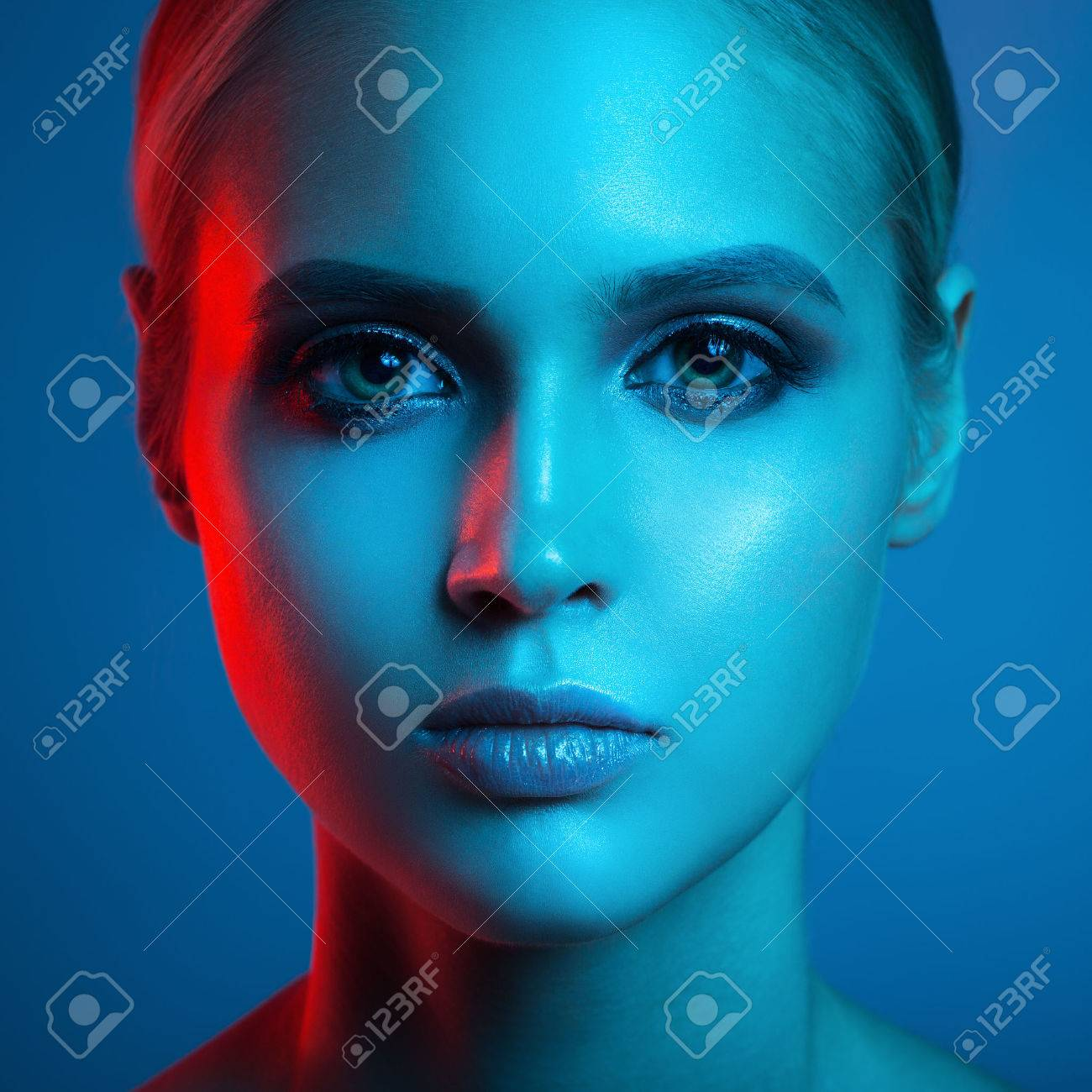 Fashion art portrait of beautiful woman face. Red and blue light color. - 75170724