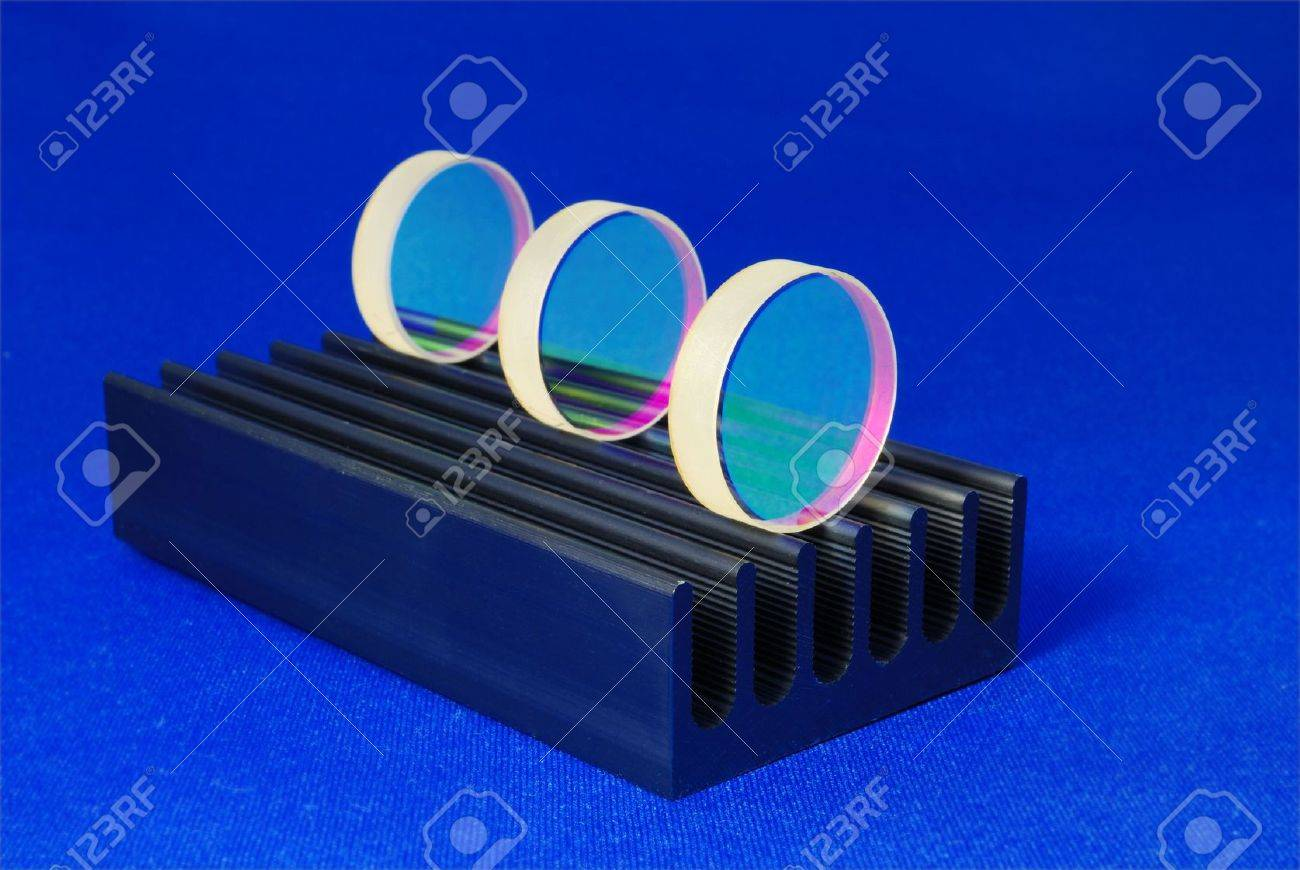 specially coated optical mirrors for laser industry and science on the black metallic rail; selective focus on front mirror Stock Photo - 5623675