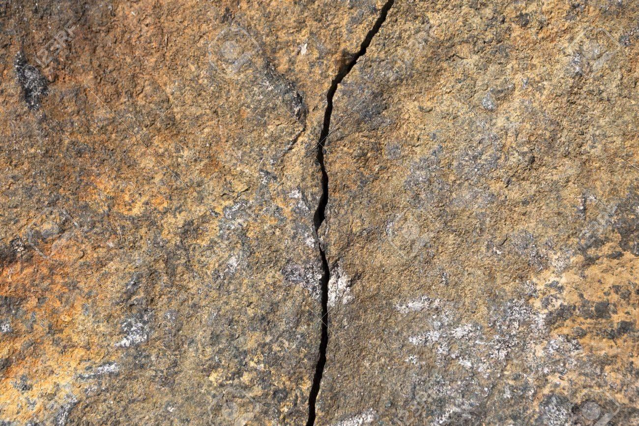 big crack divides hard stone surface Stock Photo - 14323958