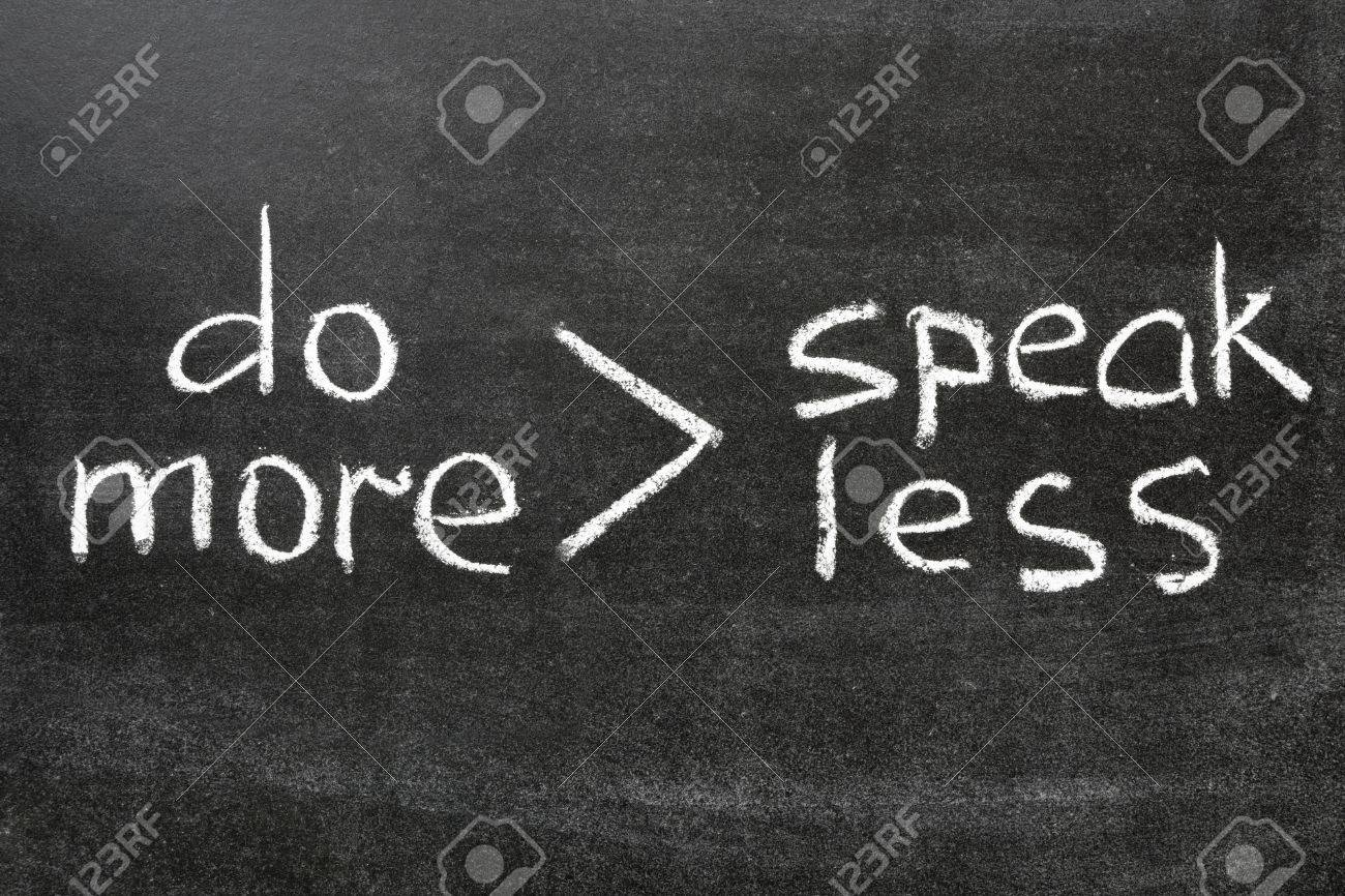 interpretation of famous phrase  speak less do more  handwritten on blackboard Stock Photo - 17684292