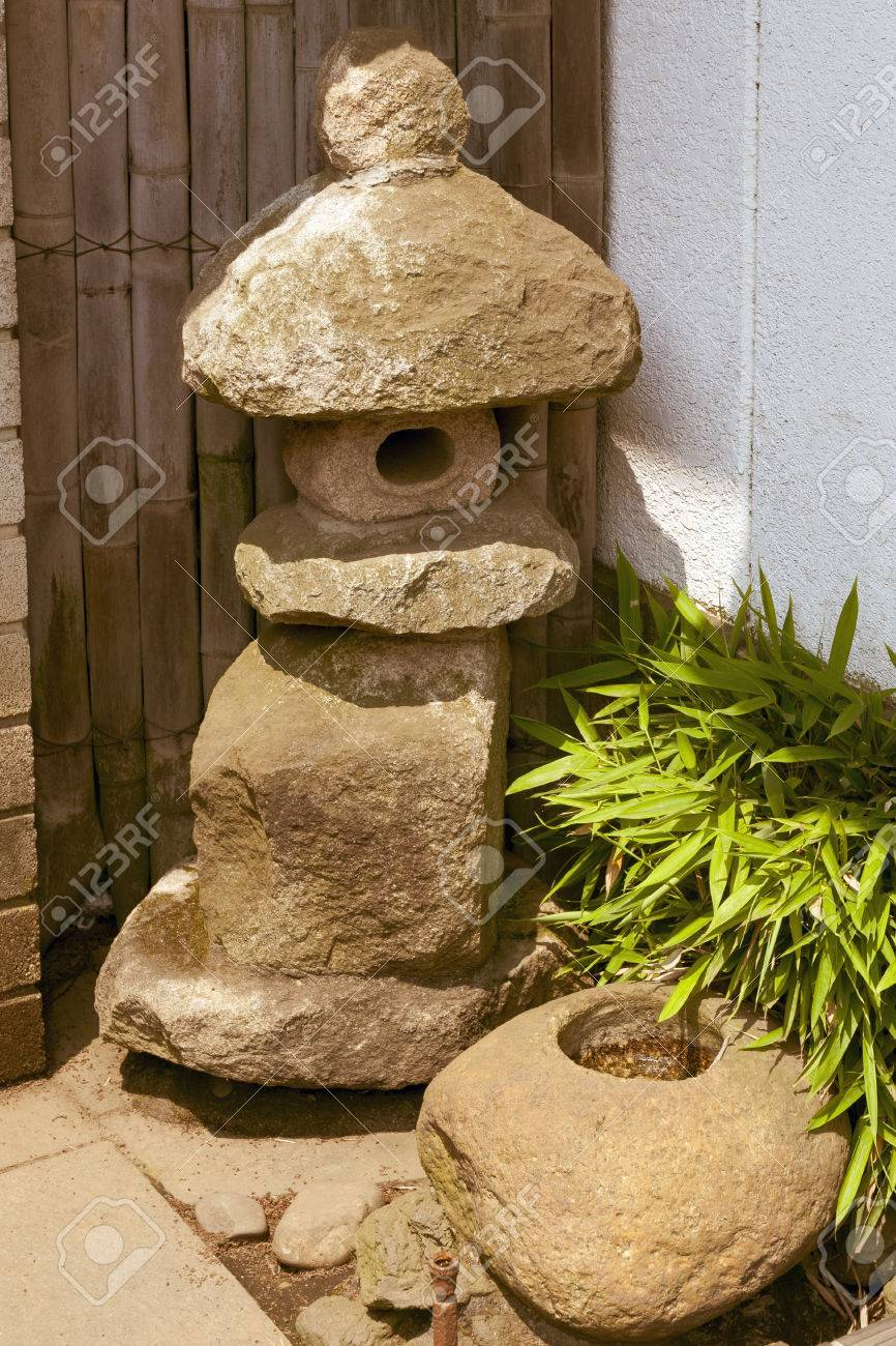 Stock photo traditional small stone lantern near japanese house