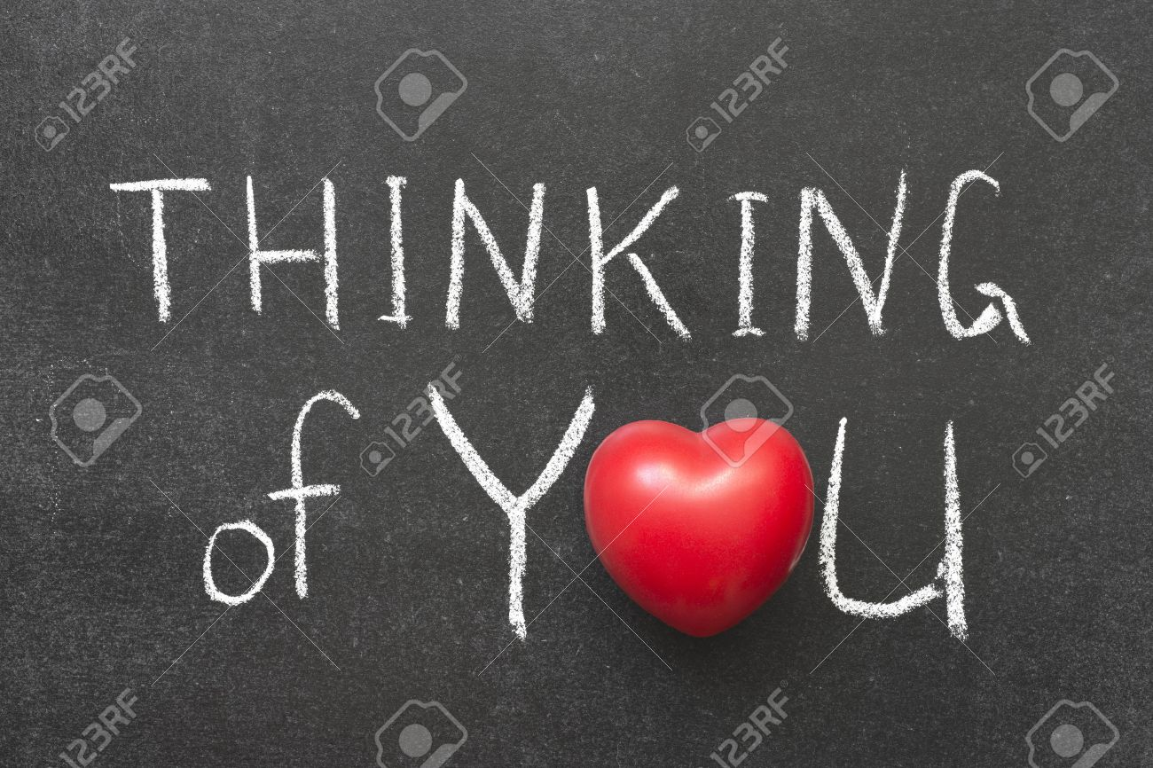 Thinking of you phrase handwritten on blackboard with heart symbol thinking of you phrase handwritten on blackboard with heart symbol instead of o stock photo biocorpaavc