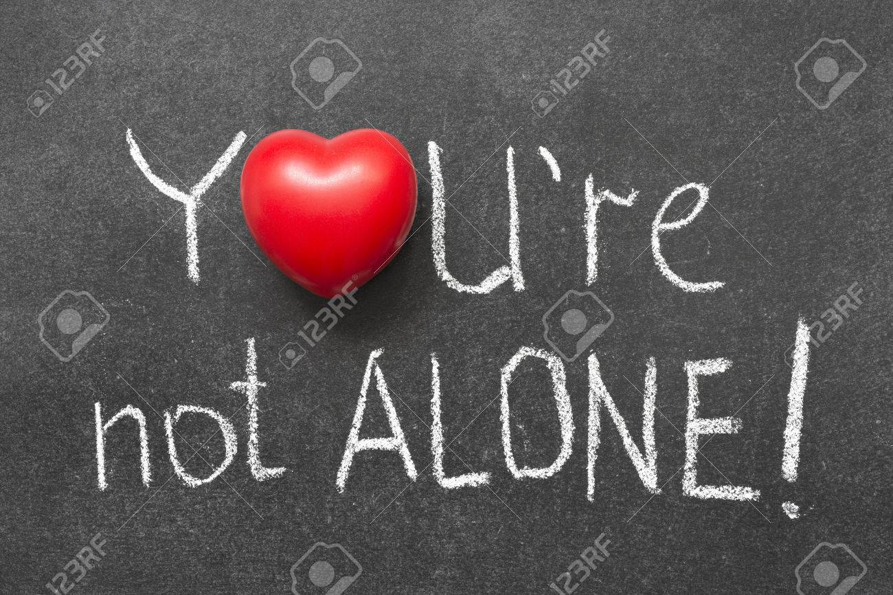 Youre not alone exclamation handwritten on blackboard with heart youre not alone exclamation handwritten on blackboard with heart symbol instead of o stock biocorpaavc