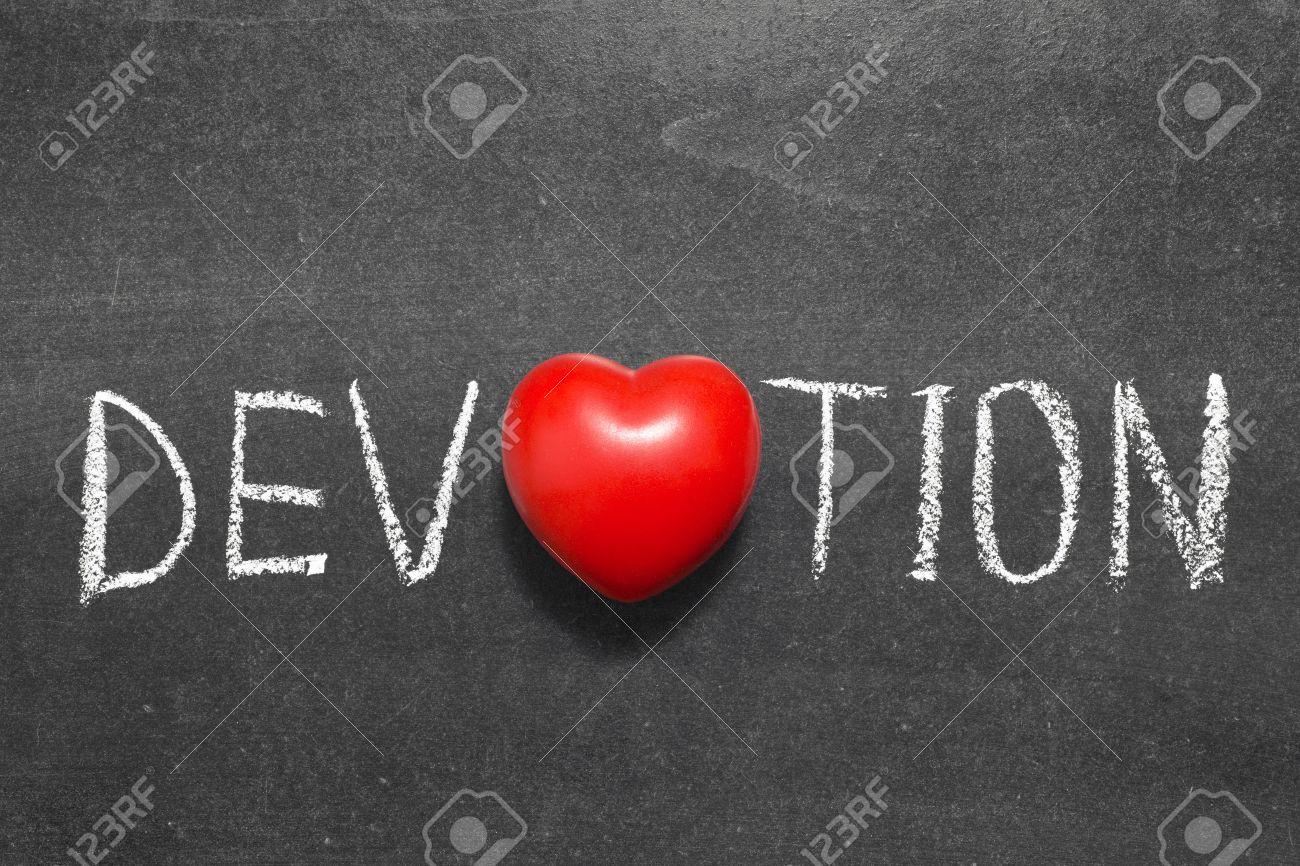 Devotion Word Handwritten On Chalkboard With Heart Symbol Instead