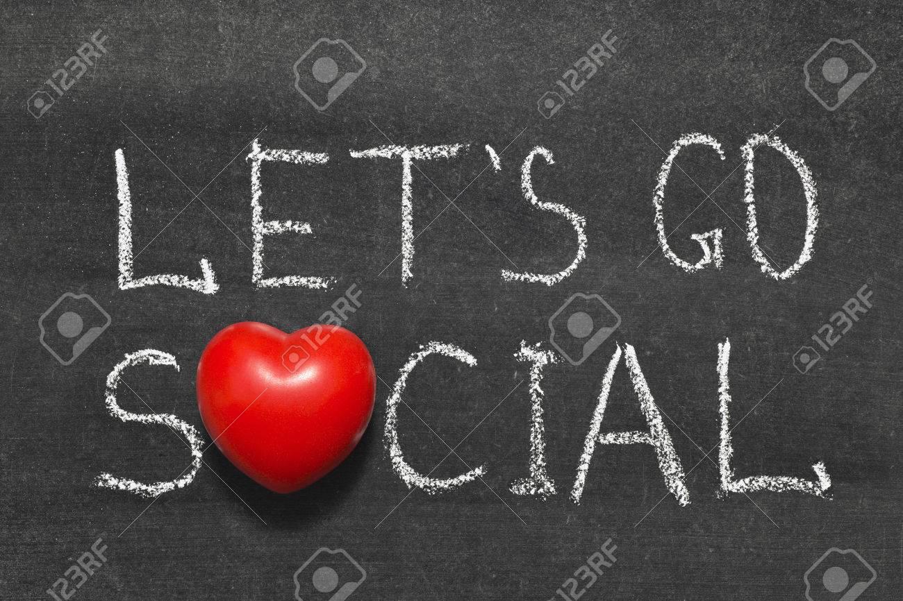 Lets go social slogan handwritten on blackboard with heart symbol lets go social slogan handwritten on blackboard with heart symbol instead of o stock photo biocorpaavc