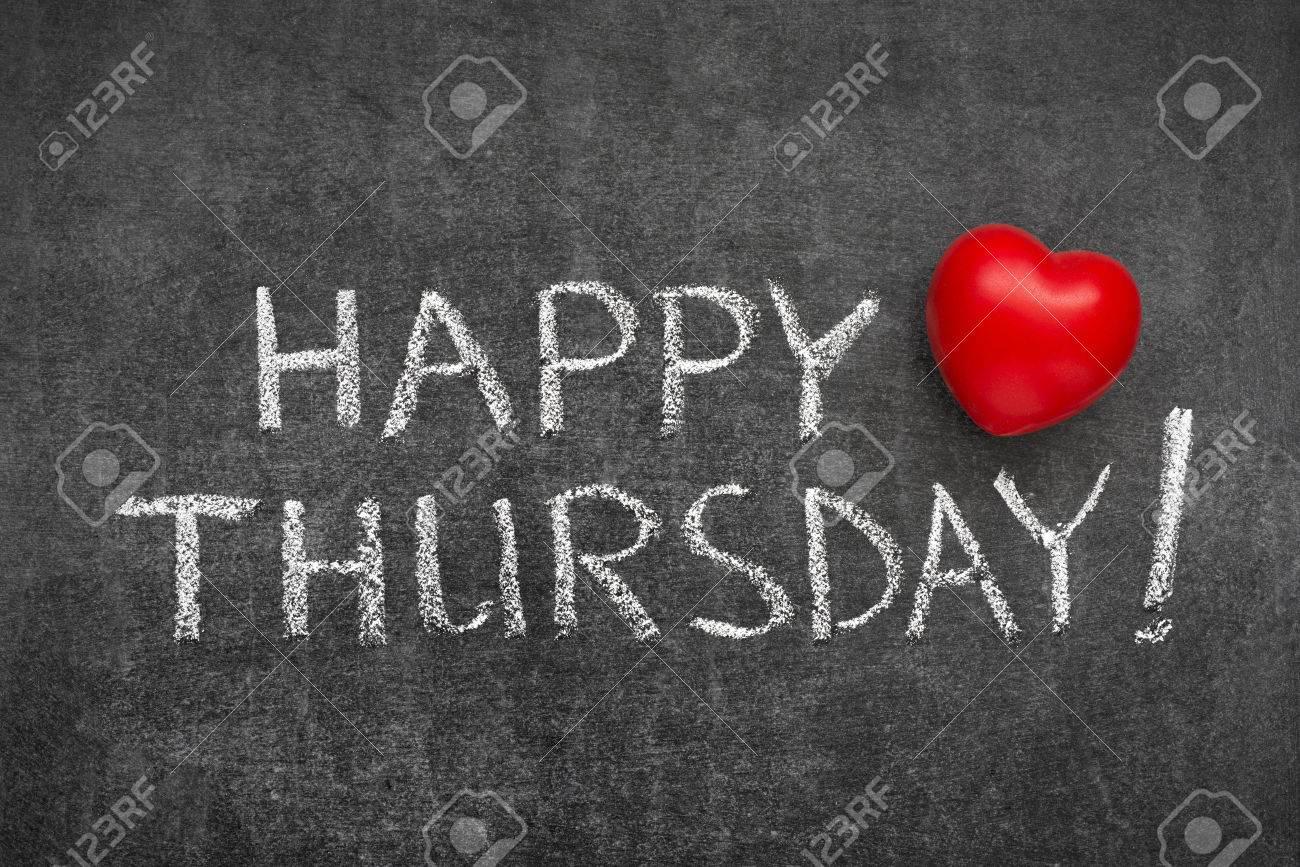 Happy Thursday Phrase Handwritten On Blackboard With Heart Symbol