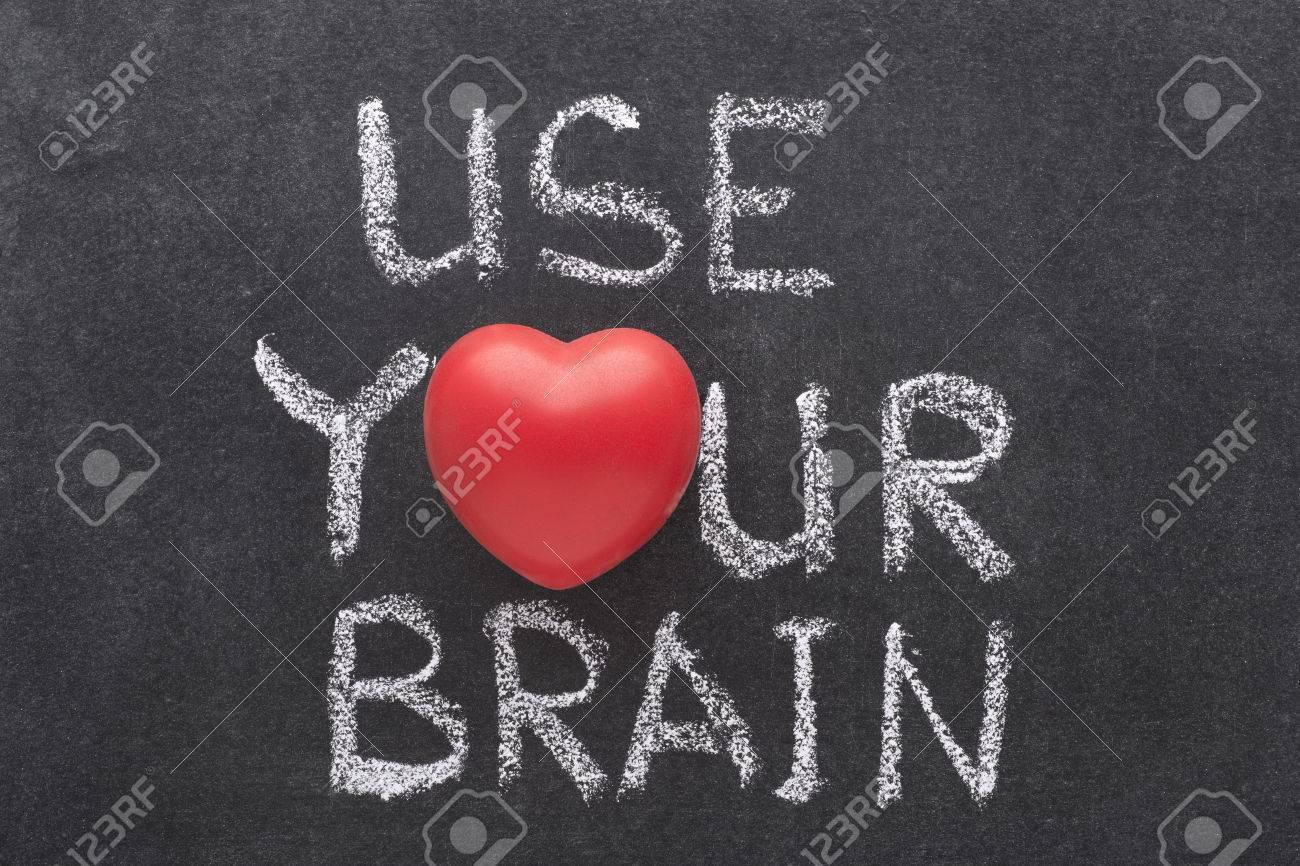 Use your brain phrase handwritten on chalkboard with heart symbol use your brain phrase handwritten on chalkboard with heart symbol instead of o stock photo biocorpaavc