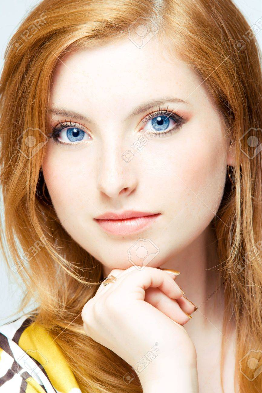 close up studio shot of young beautiful readhead woman - 5405750