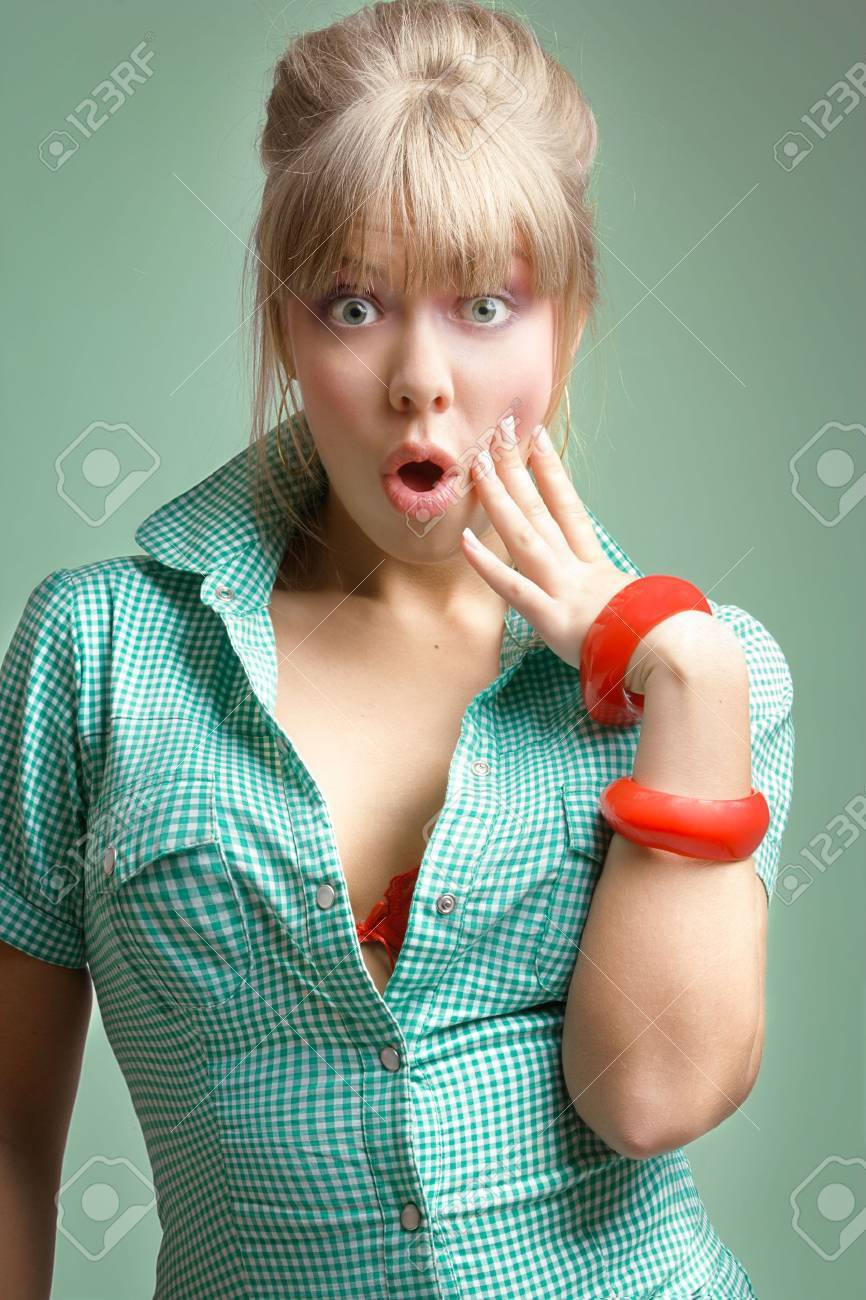 young surprised blonde posing over green background Stock Photo - 6260788